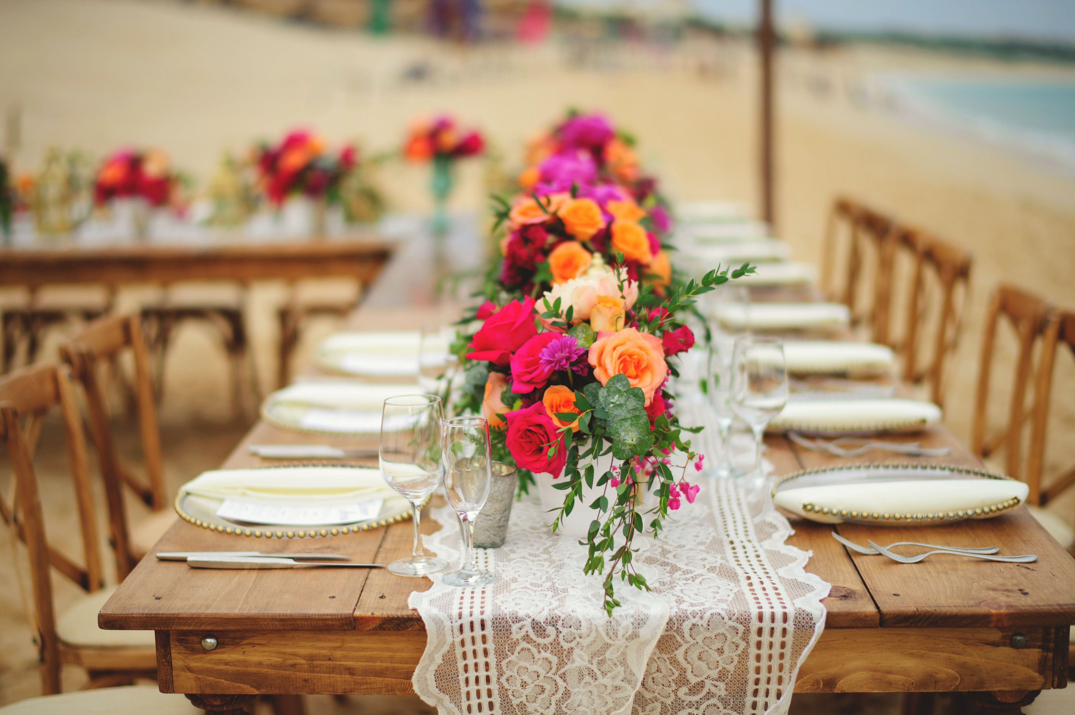Reception Wedding and design by Cabo Wedding Services at Villa la Estancia in Cabo San Lucas. Table arrangements with Peonies and Roses