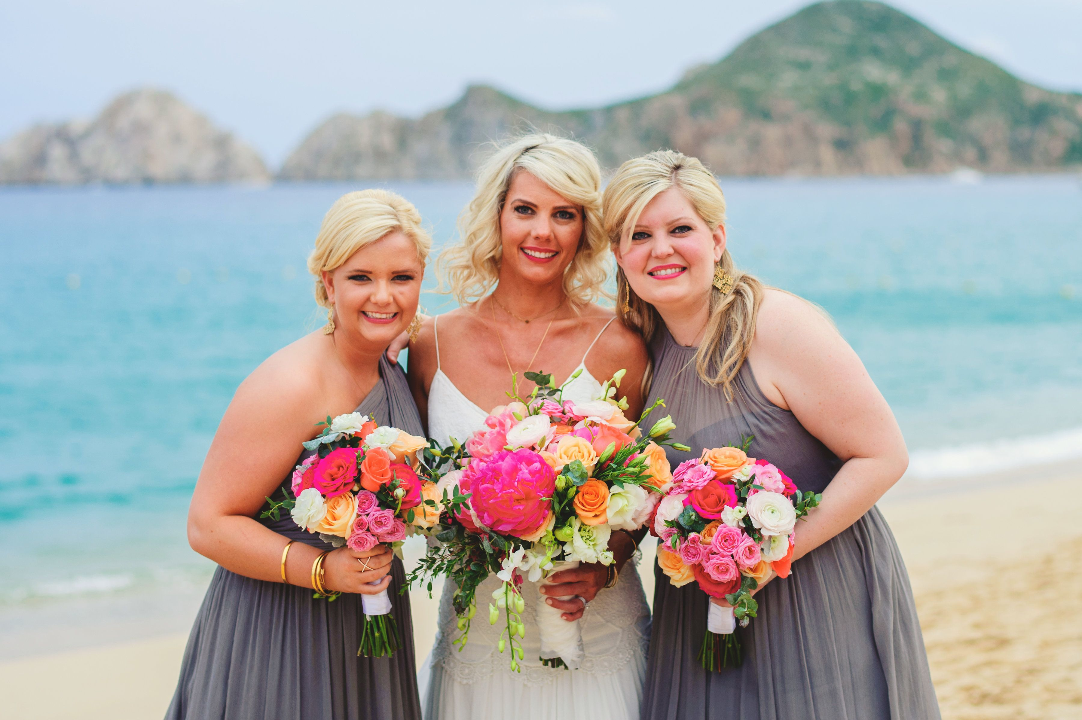bride with bridesmaids at beach wedding in Cabo San Lucas with Peonies Bouquets