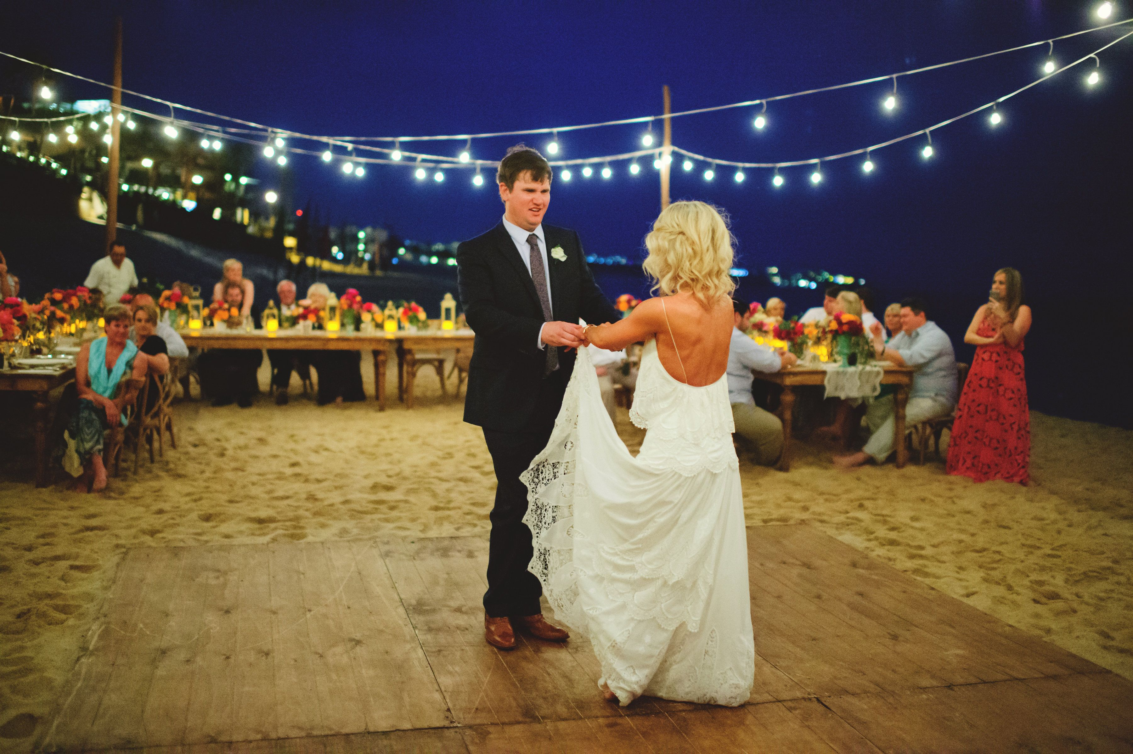 Bride and groom having first dance as husband and wife at their wedding in Cabo San Lucas. Designed and coordinated by Cabo Wedding Services