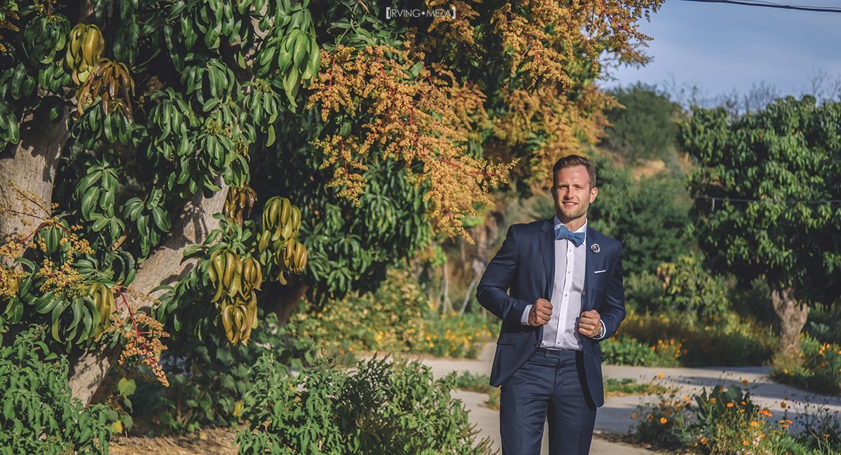 Groom walking down the Aisle at Wedding Venue at Flora Farms in Cabo San Lucas Mexico