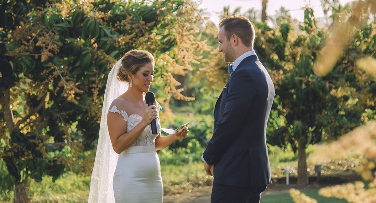 Bride and Groom saying their vows at Flora Farms in Cabo San Lucas Mexico