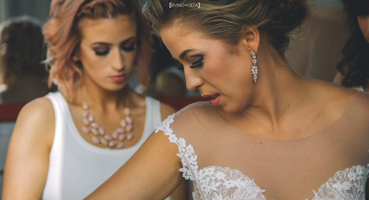 Bride with her bridesmaids getting ready at wedding venue Flora Farms in Cabo San Lucas Mexico