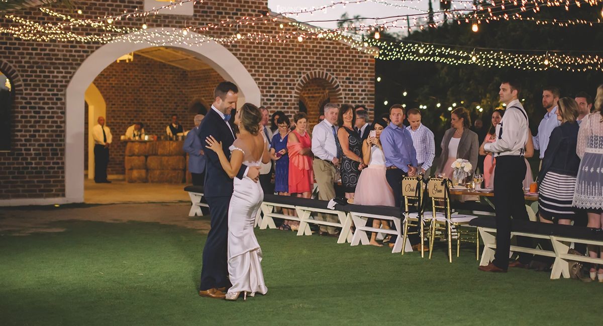 Bride and Groom First Dance as Husband and Wife at Wedding Venue Flora Farms in Cabo San Lucas Mexico
