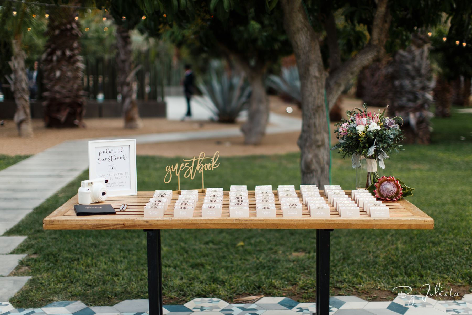 Escort Guest Signing Book Table at Acre Baja designed by Jesse Wolff and coordinated by Cabo Wedding Services