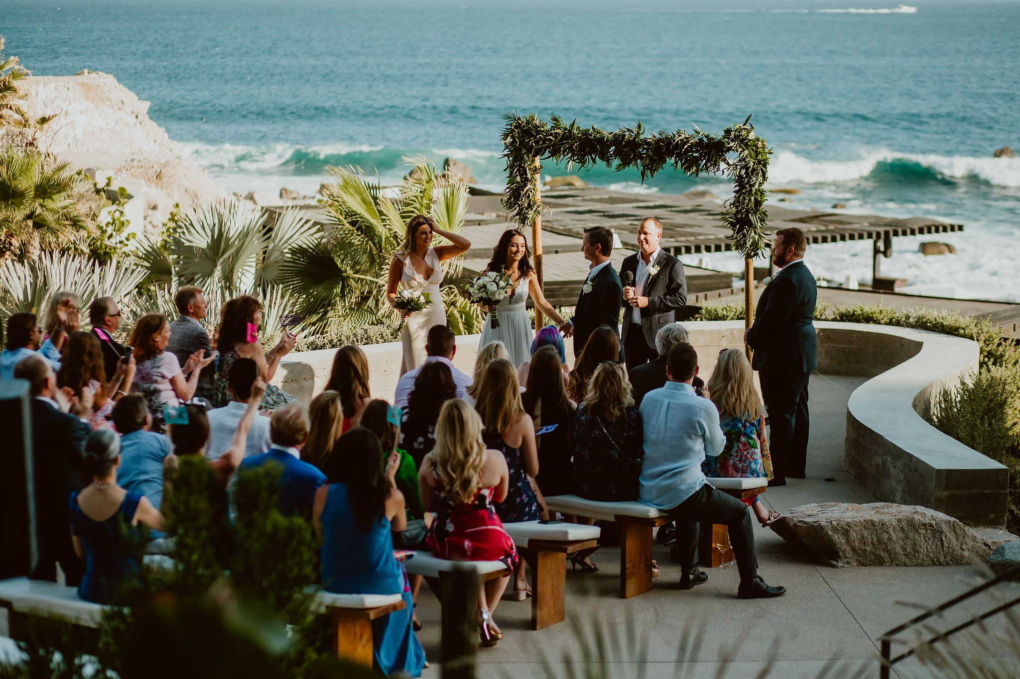 Wedding Ceremony happening at the upper terrace at The Cape in Los Cabos Mexico