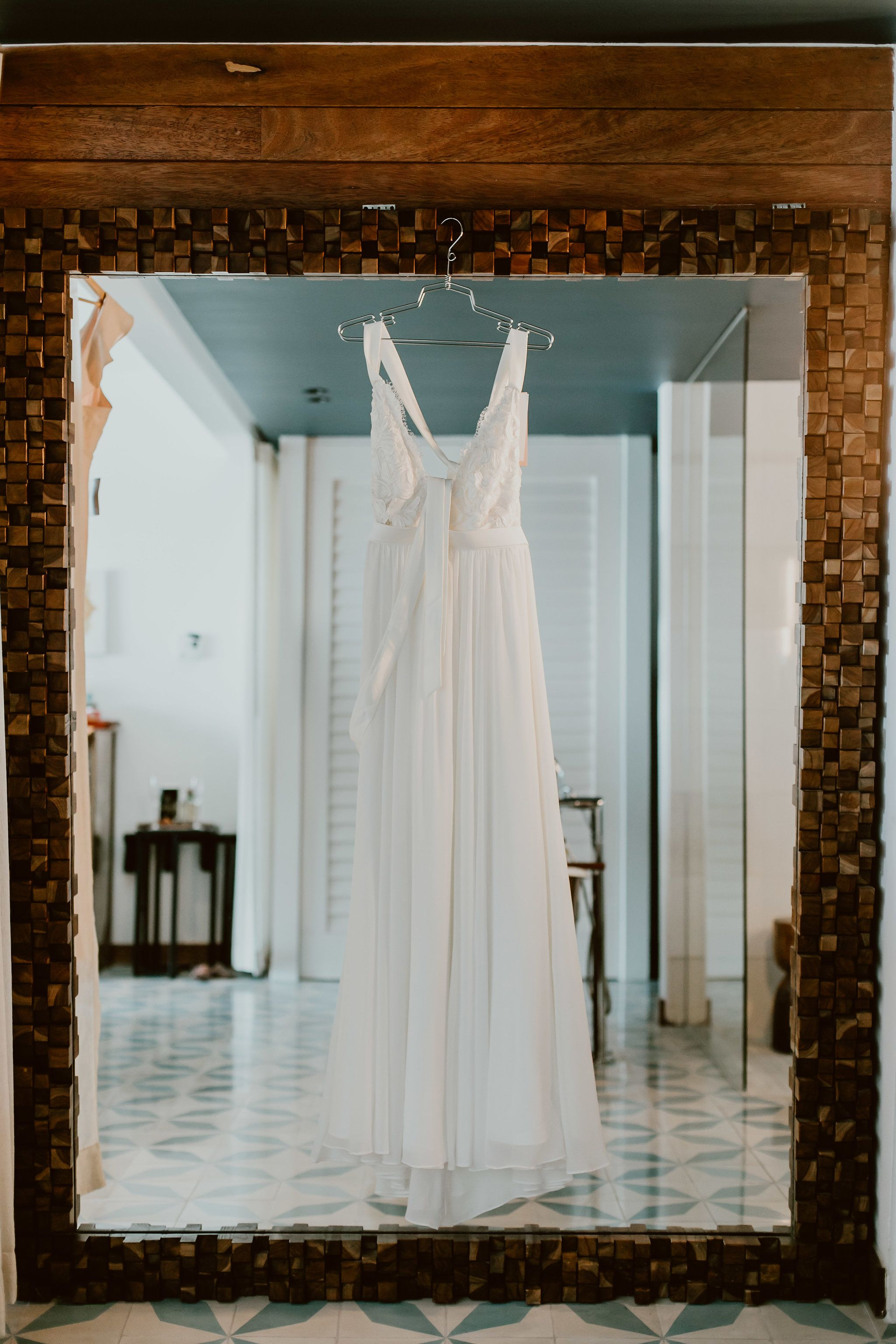 Brides dress hung at The Capes hotel room in Los Cabos Mexico