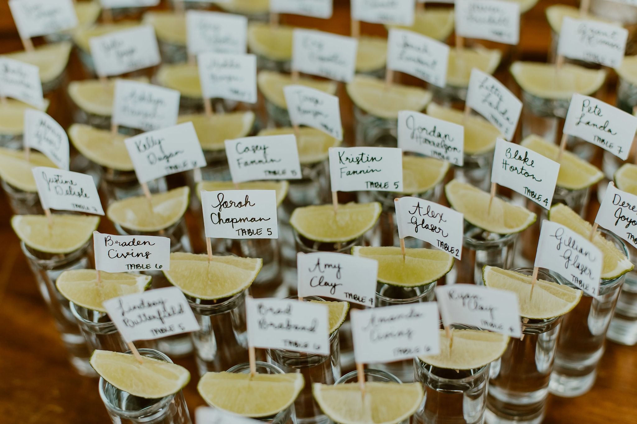 Tequila seating card ideas with lemon and name tag at Wedding venue The Cape by Thompson Hotels in Los Cabos Mexico