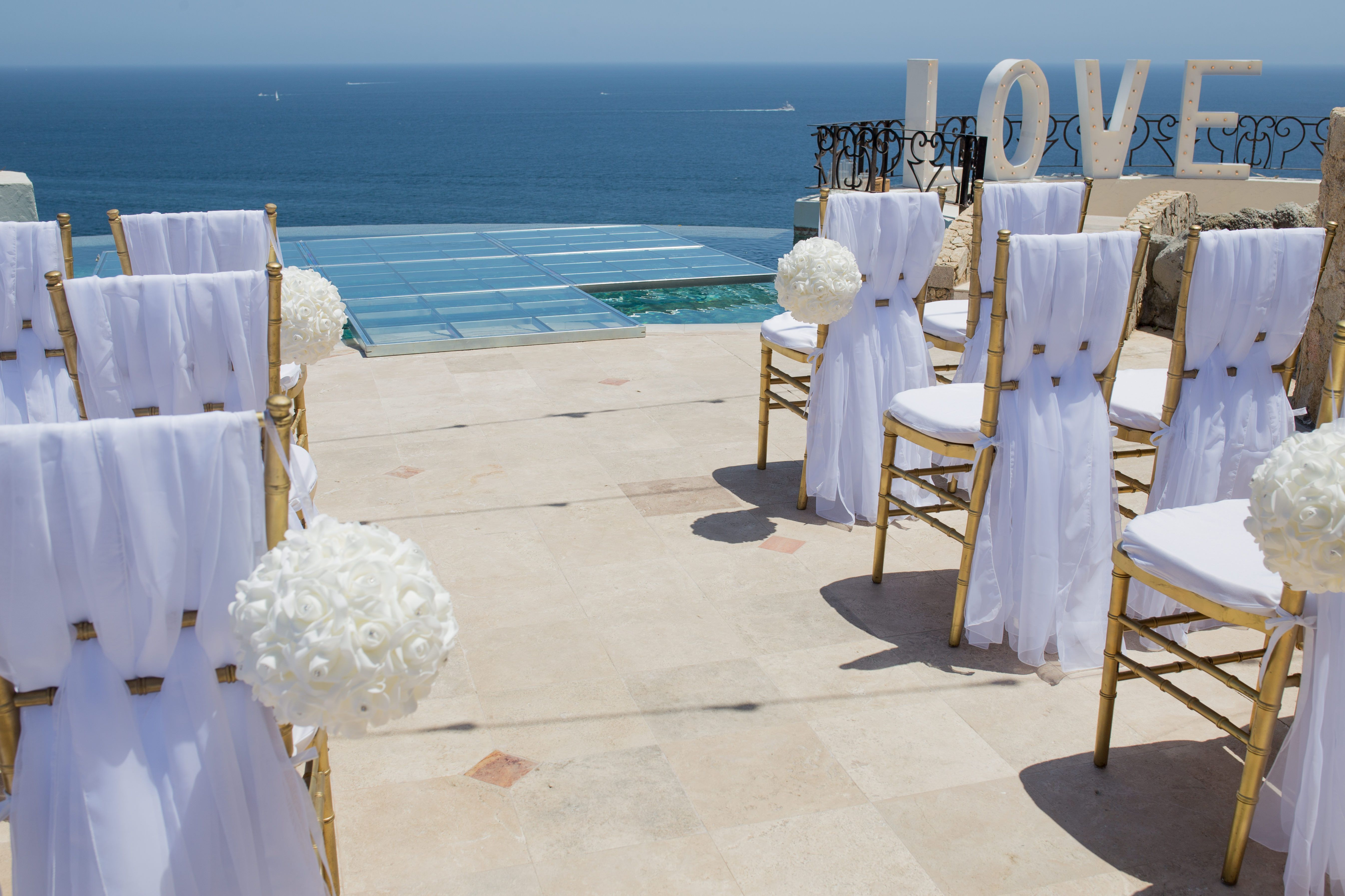 Ceremony chair setup before ceremony at Villa la Roca in Cabo San Lucas Pedregal