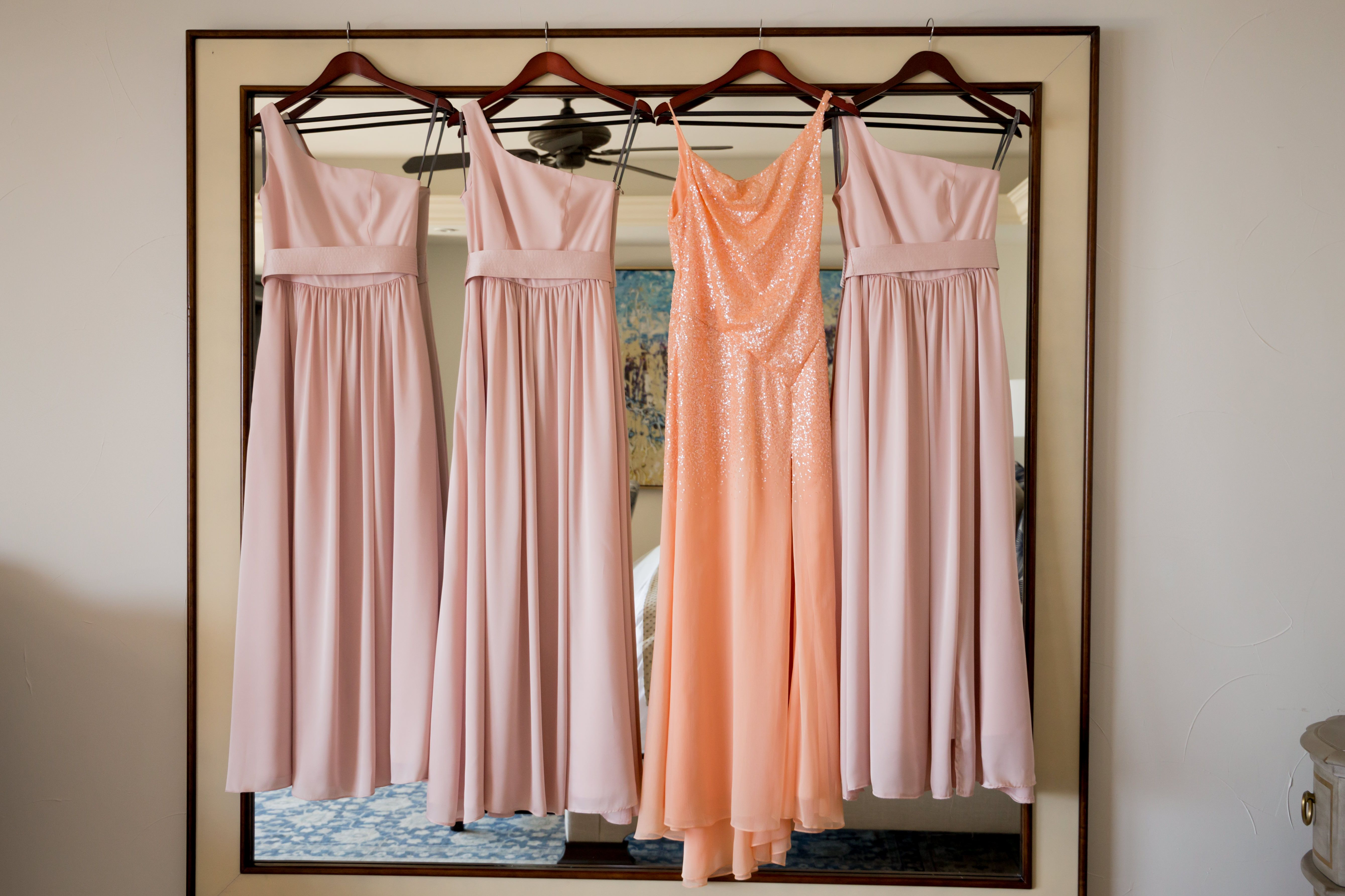 Bridesmaid dresses hanging up before wedding ceremony. My bride decided to go with pastel colors because the Villa had such neutral colors, they contrasted perfectly