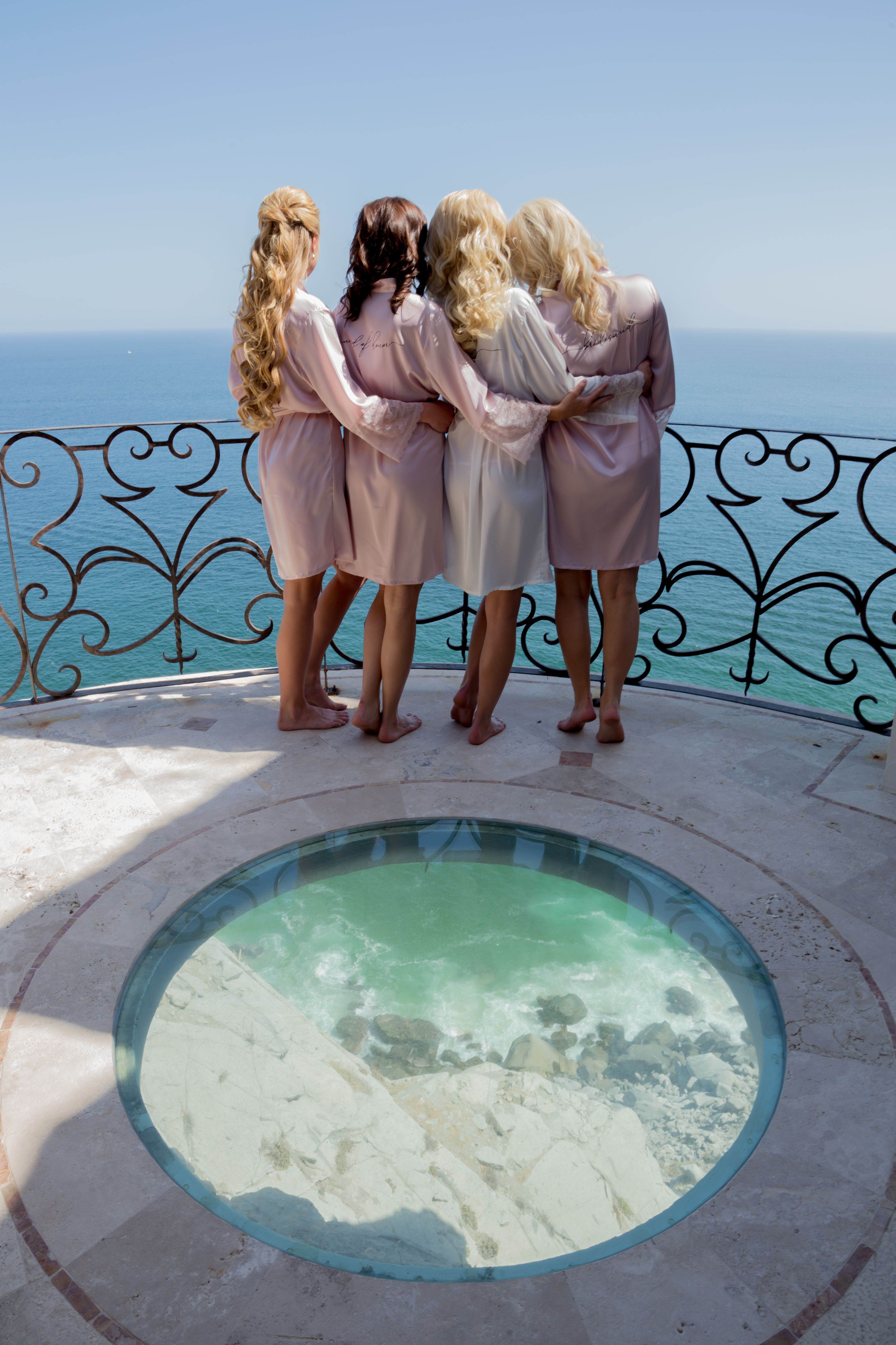 Bride with her bridesmaids before getting in to their dresses and being the Ceremony. This photo is amazing because of the glass window it has to look down at the Pacific Ocean