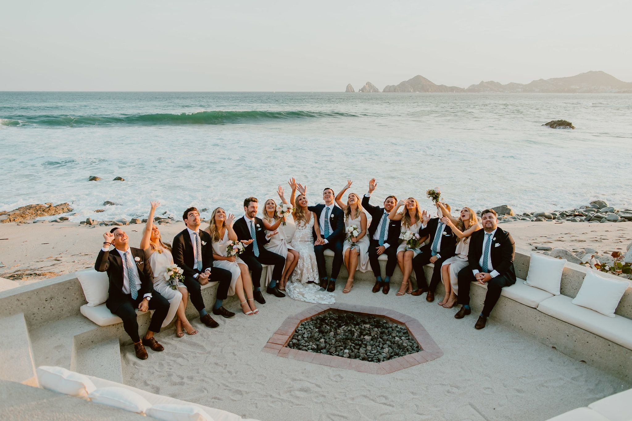 Photo Session with the Bride and Groom at the fire pit on the Beach at The Cape Hotel in Cabo San Lucas Mexico. The famous Arch behind them as well as the Sea of Cortez made everything perfect. The waves also looked amazing.