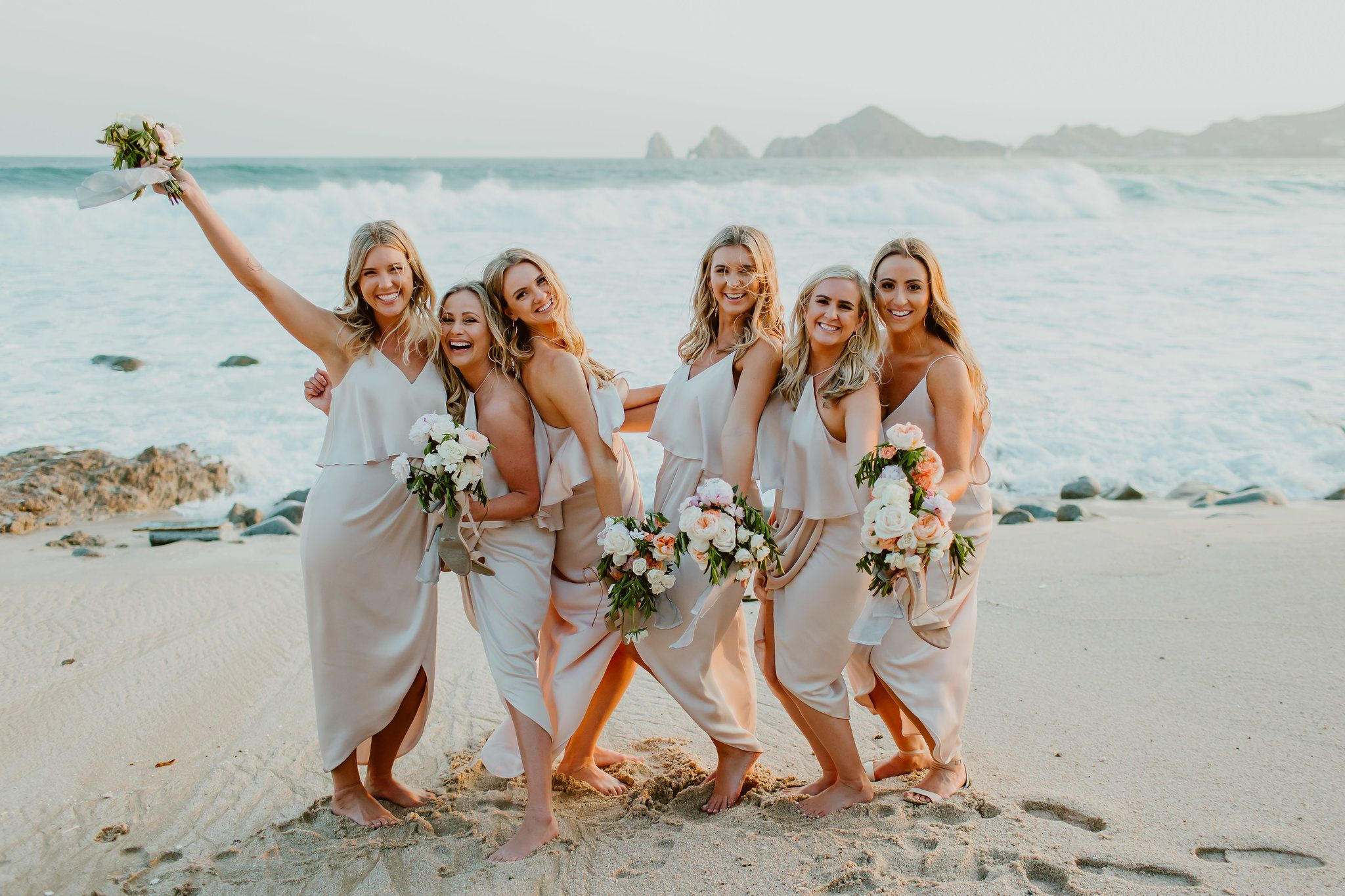Bridesmaids having fun infront of the Sea of Cortez at Dana and JJ´s wedding in Los Cabos Mexico. Photography by Ana and Jerome. Wedding Planning by Cabo Wedding Services
