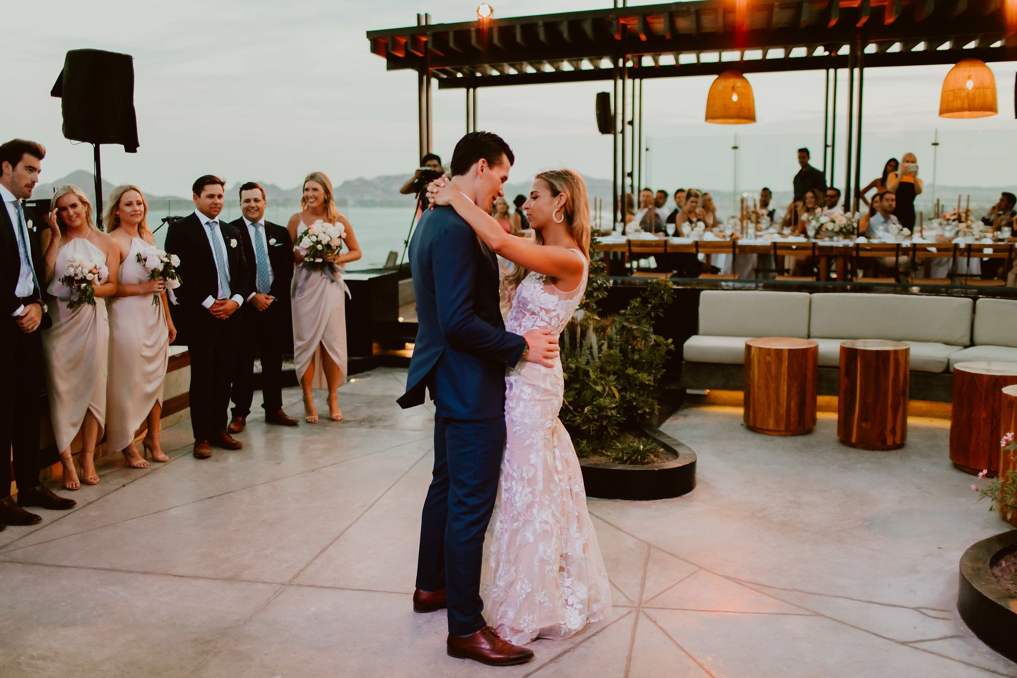 Bride and groom having their first dance at the rooftop at The Cape in Los Cabos, Mexico. They had all of their close family and friends watching as they has their first dance as husband and wife.