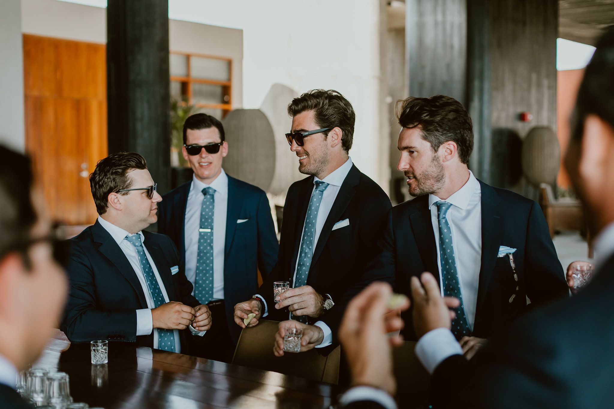 The groom and groomsmen having a shot right before the ceremony begins. This photo was taken at the Lobby bar at The Cape by THompson Hotels in Cabo San Lucas. Wedding Planning was done by Cabo Wedding Services.