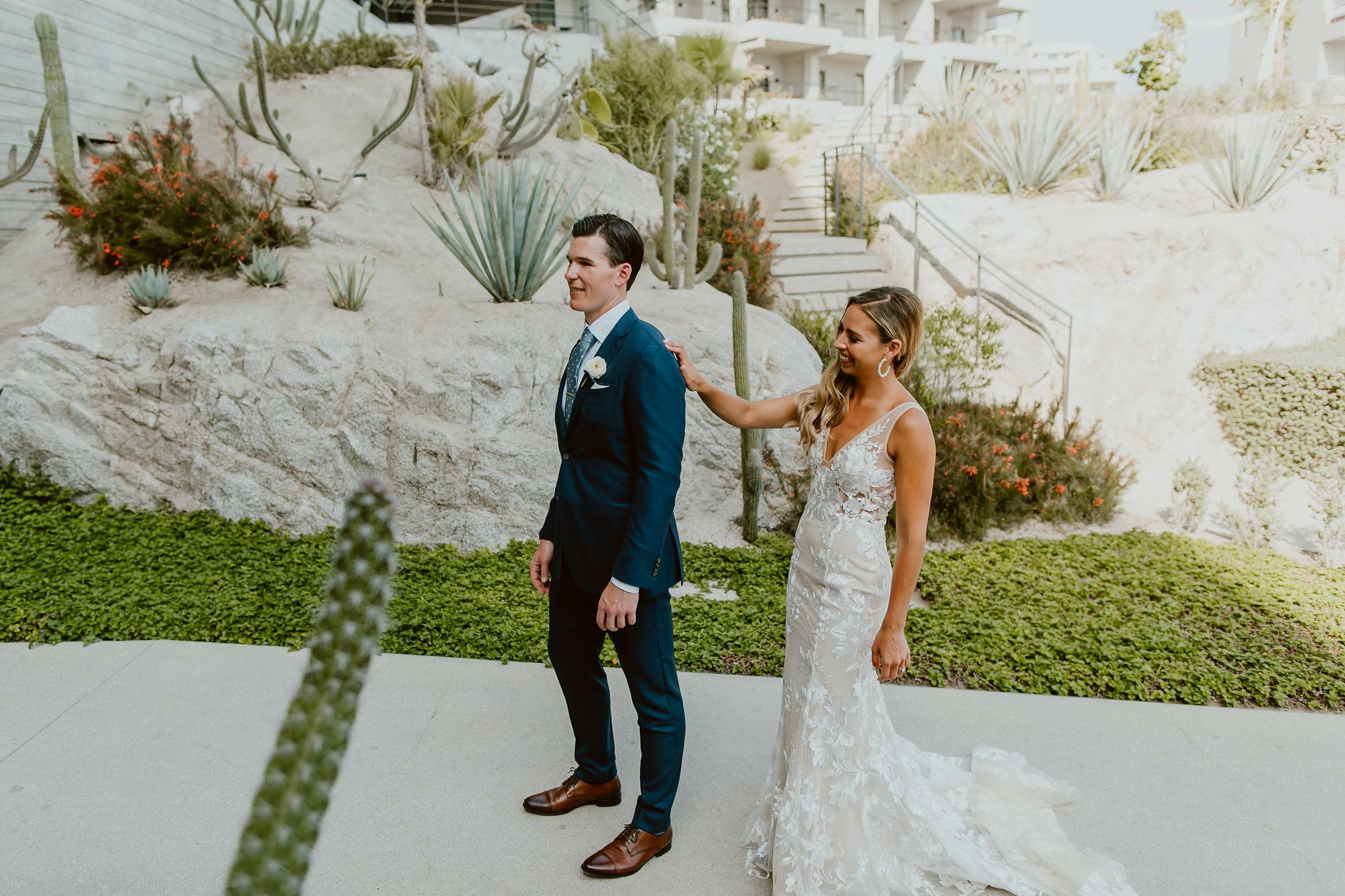 This photo was taken right before the Wedding Ceremony as the Bride and Groom did their first Look. This photo was taken by the Pool at the Cape by Thompson Hotels, planned and designed by Cabo Wedding Services