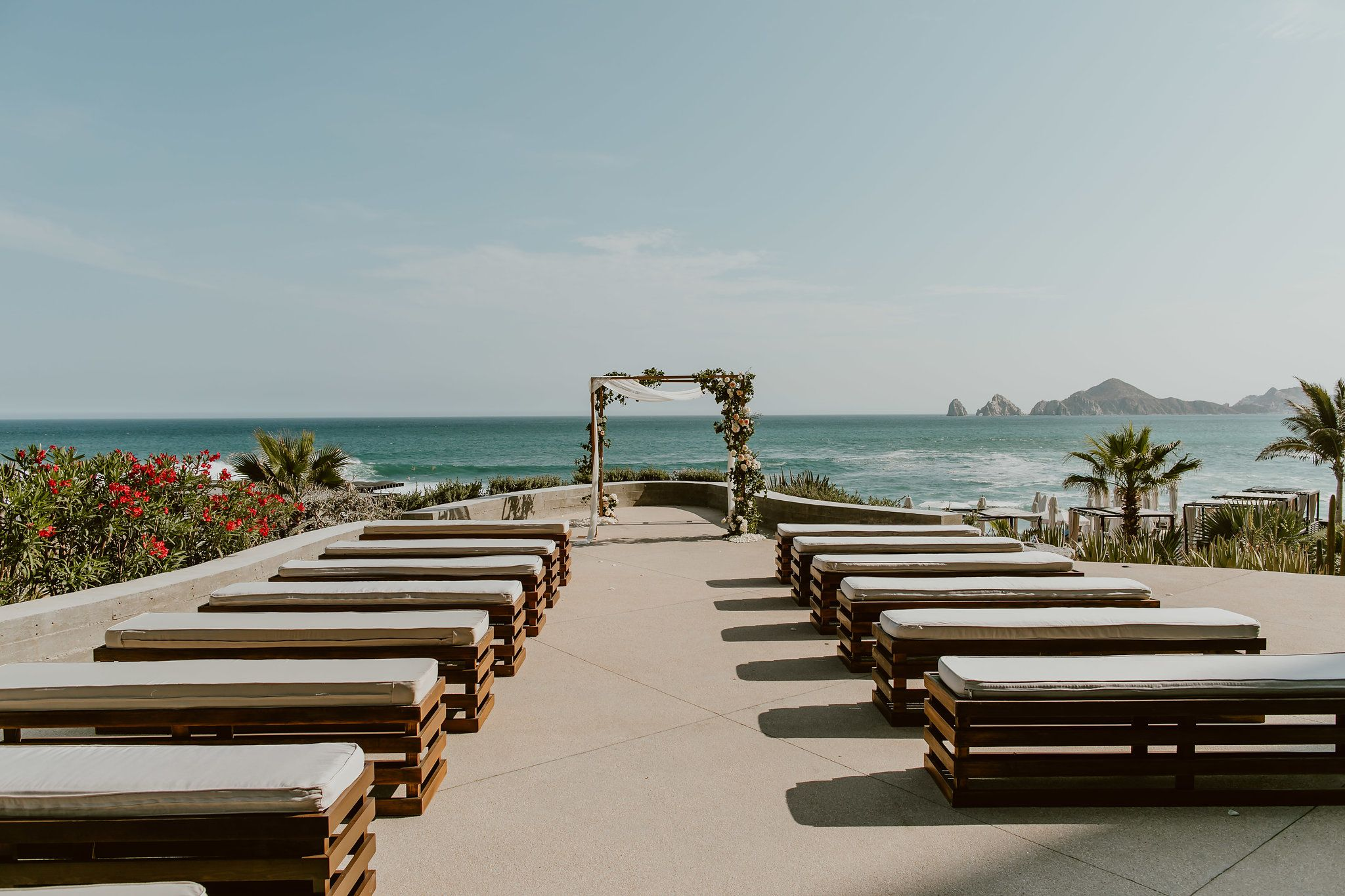 This was the Wedding Ceremony setup and design overlooking the Sea of Cortez. The famous landmark of the Arch is in the background. This was taken by Ana and Jerome at The Cape, by Thompson Hotels in Cabo San Lucas Mexico. Wedding Planning by Cabo Wedding Services