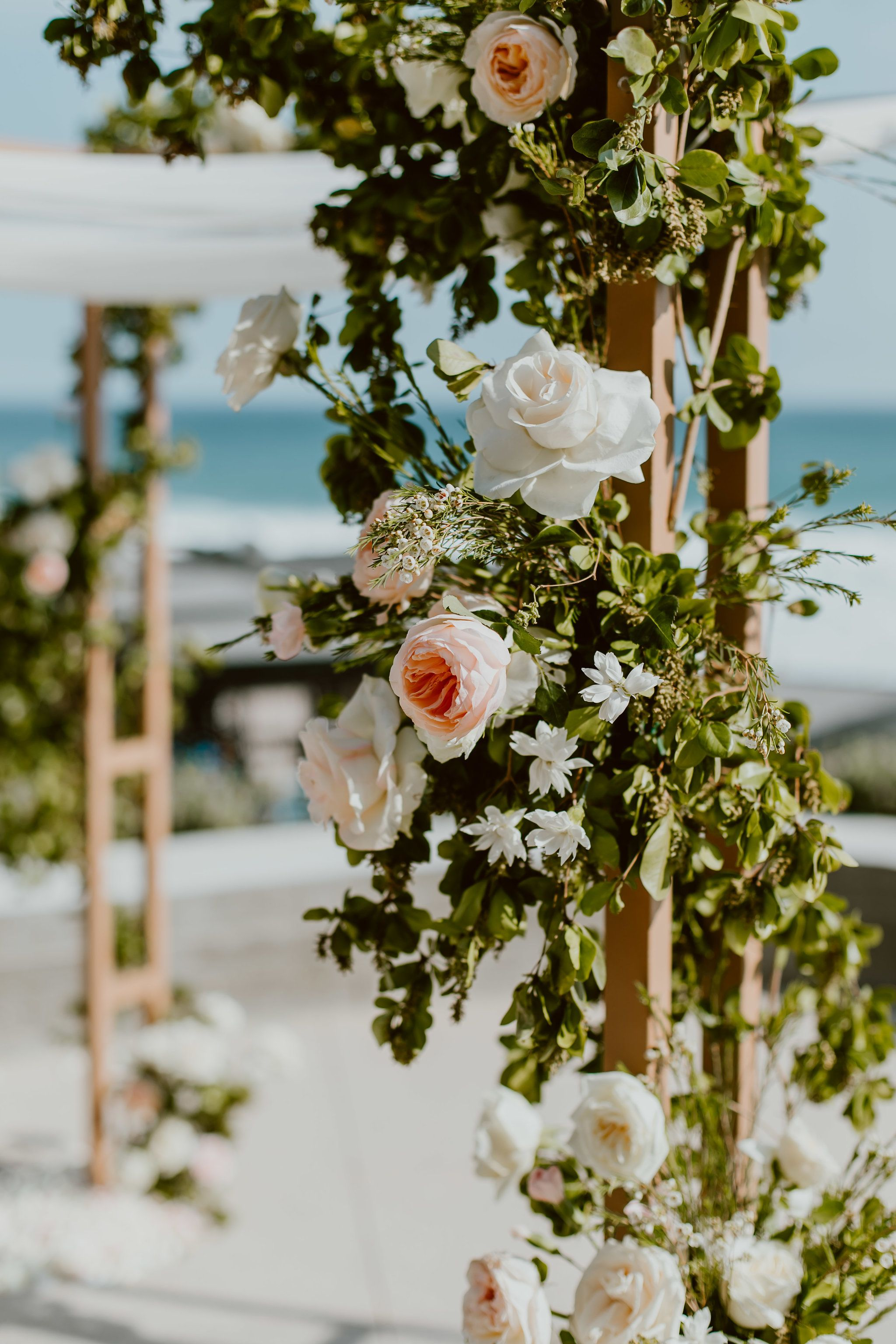 Flower details of roses, Peonies, Ranunculus and greenery for dana and JJ´s wedding at The Cape, by Thompson Hotels. Lola from Florenta Flower Design did this ceremony alter. Wedding Planning by Cabo Wedding Services