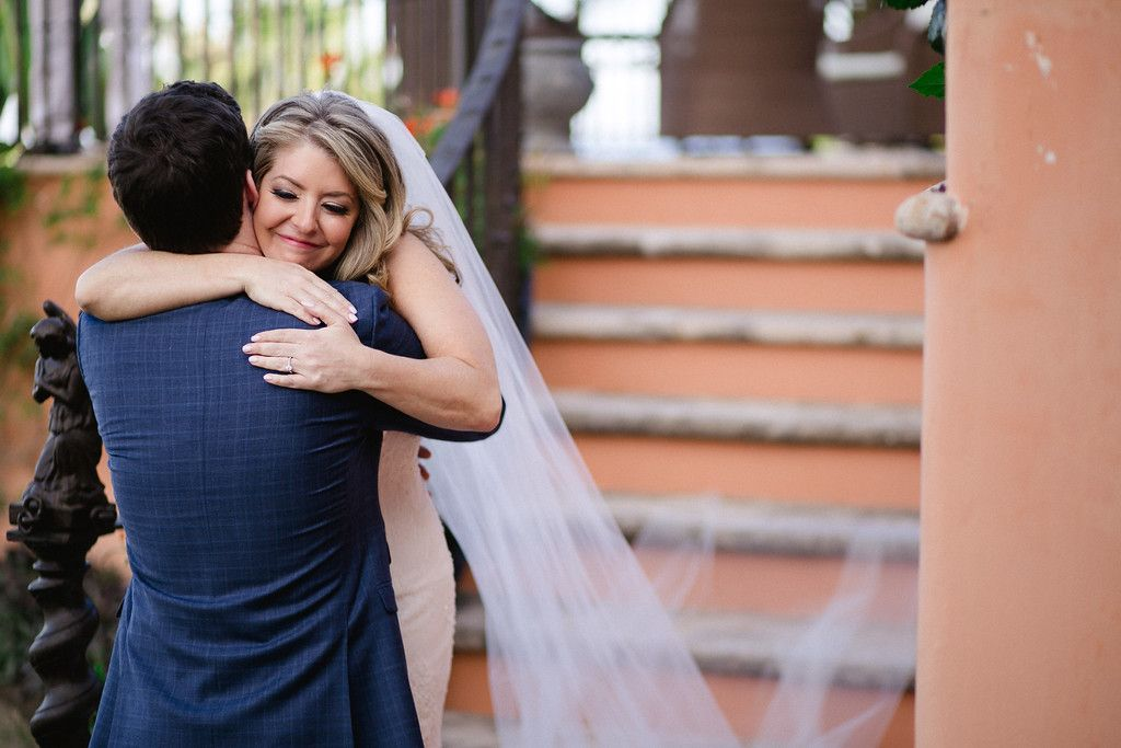 Bride and Groom hugging after doing First Look at Cabo del Sol in Cabo San Lucas, Mexico. They were married at a Villa and had a Villa Wedding inside the cabo del Sol complex. Wedding Planning was done by Cabo Wedding Services