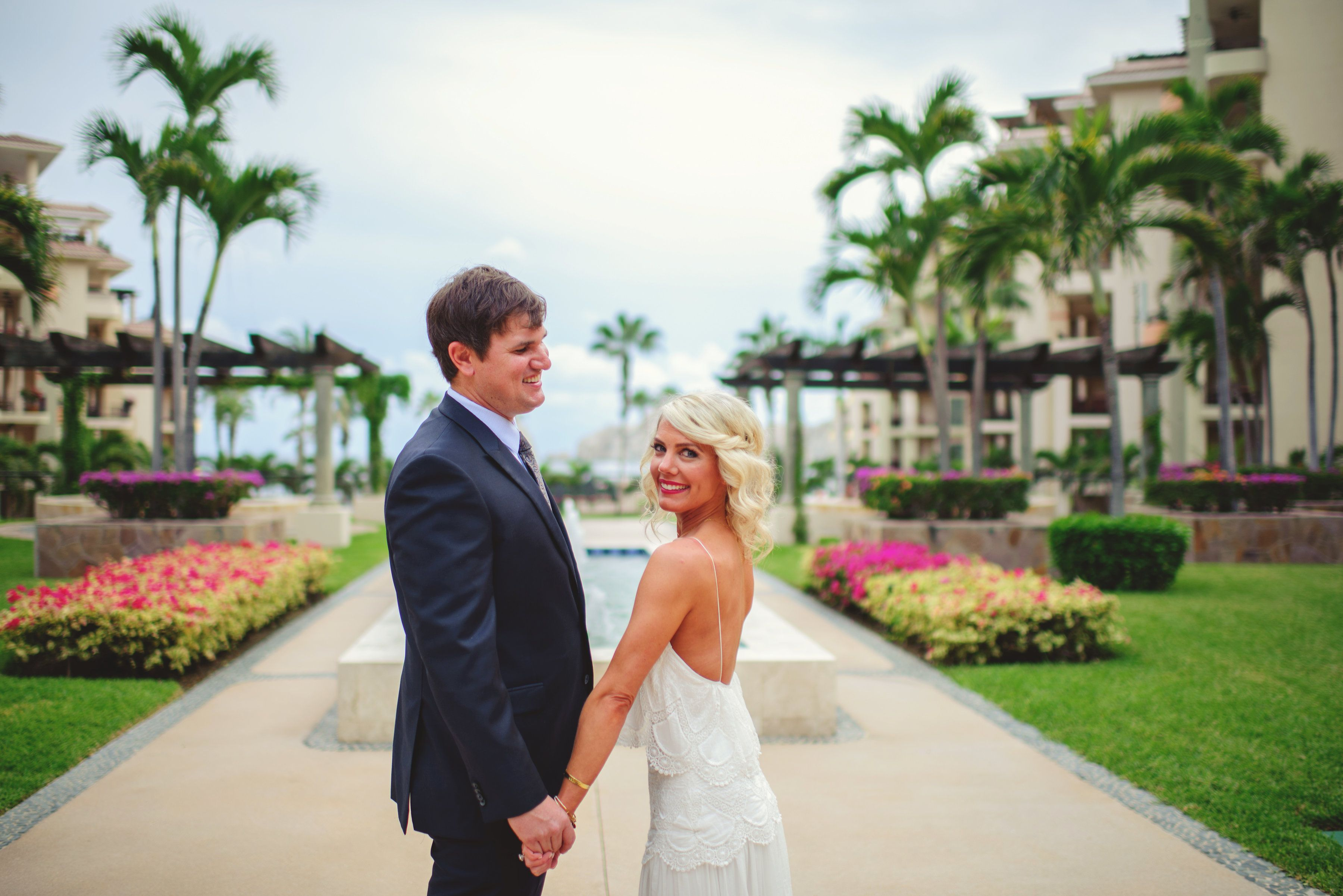 Bride and groom getting photo session at Villa de la Estancia in Cabo San Lucas, Mexico, right before their Wedding Ceremony at their Destination Wedding in Mexico. Wedding Planning by Cabo Wedding Services.