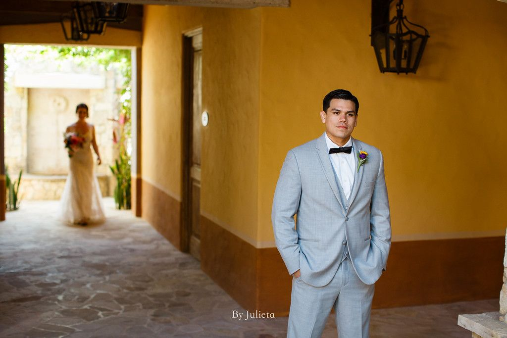 Bride walking behind the groom at Hacienda Cocina and Cantina moments before the Ceremony. Julieta Amezcua was able to take the best photos of this couple in Los Cabos, Mexico.