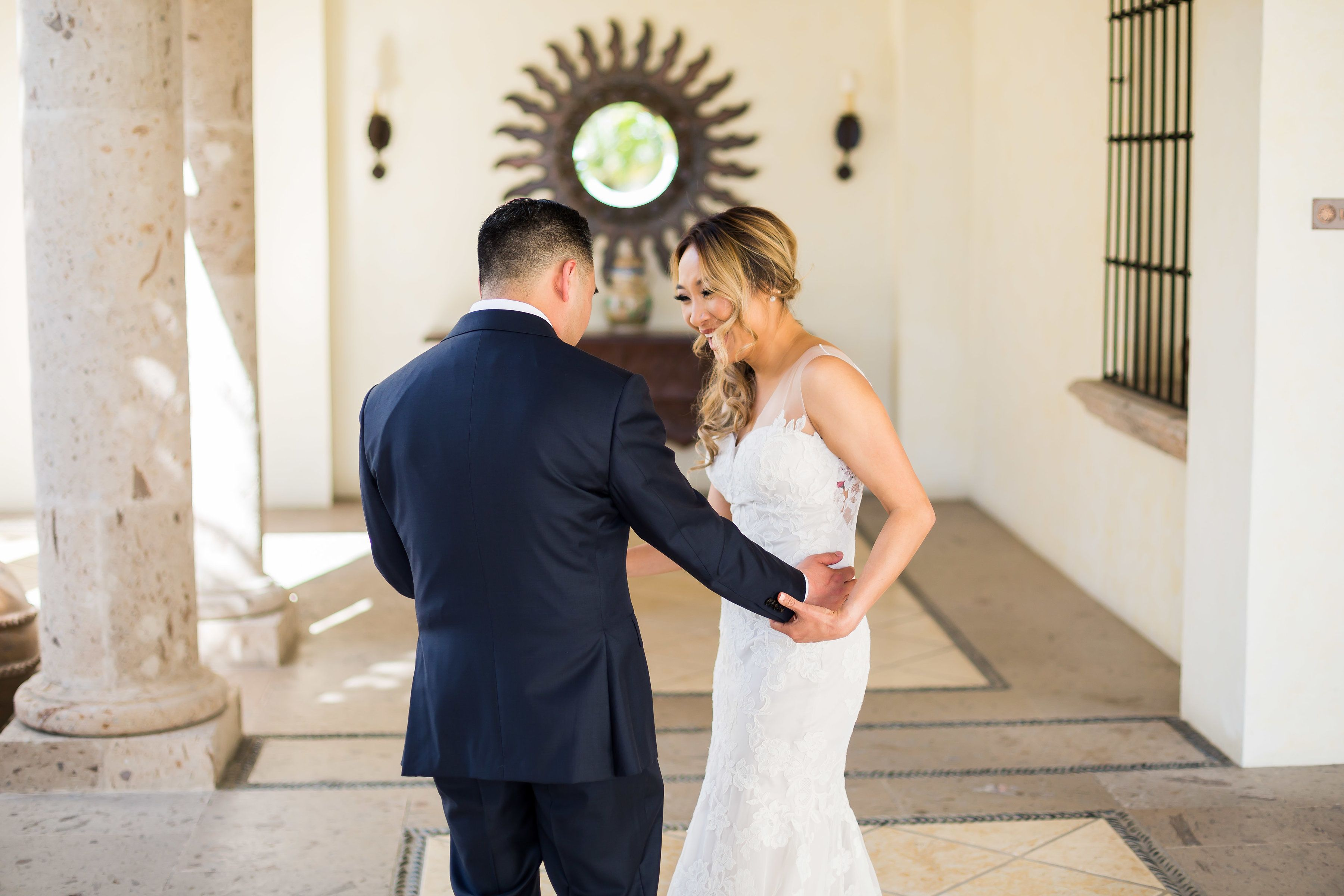 Groom seeing the Bride for the First Time before the Ceremony doing their First Look. The Wedding Venue is at Cabo del Sol, located in Cabo San Lucas Mexico. Wedding Planning by Cabo Wedding Services. The Photographers were Ana and Jerome