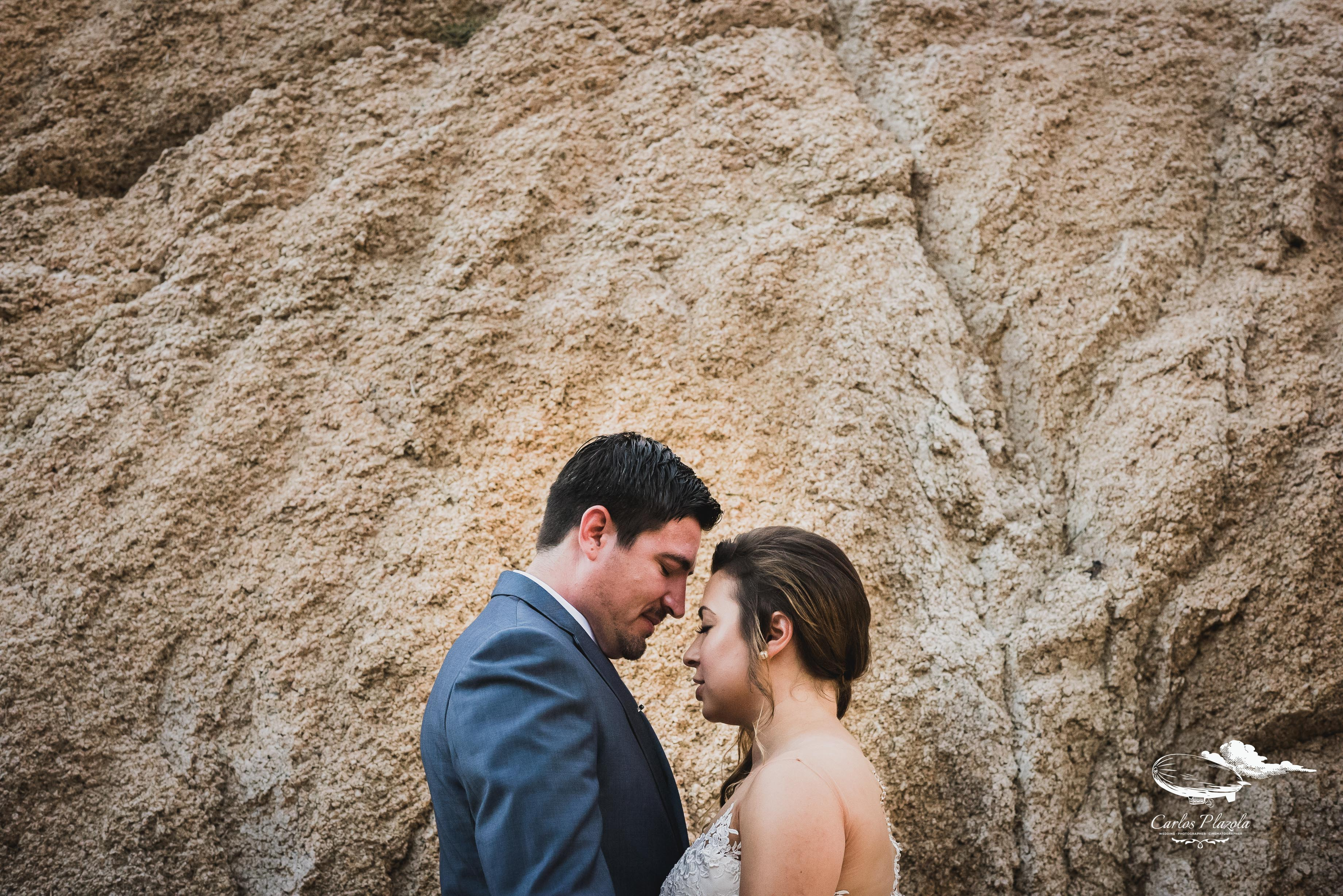 Bride and groom kissing each other and hanging out prior to the ceremony, just getting some together time. They were such a sweet couple and the ceremony took place at Wedding Venue Grand Fiesta Americana Los Cabos. Wedding planning and design by Cabo Wedding Services