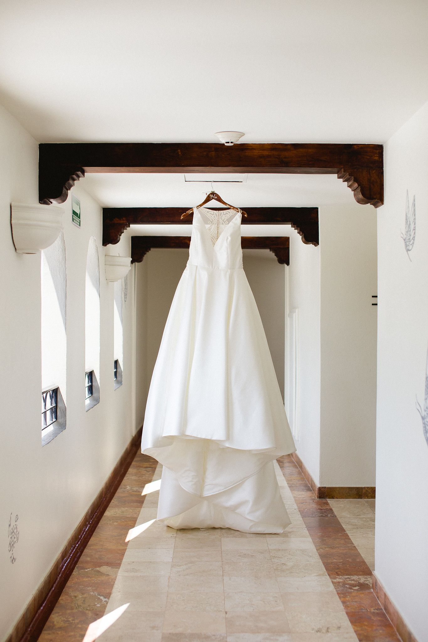 Wedding dressn worn by our beautiful bride who got ready at the Hilton Los Cabos in Mexico. Destination Wedding Planned and designed by Cabo Wedding Services.