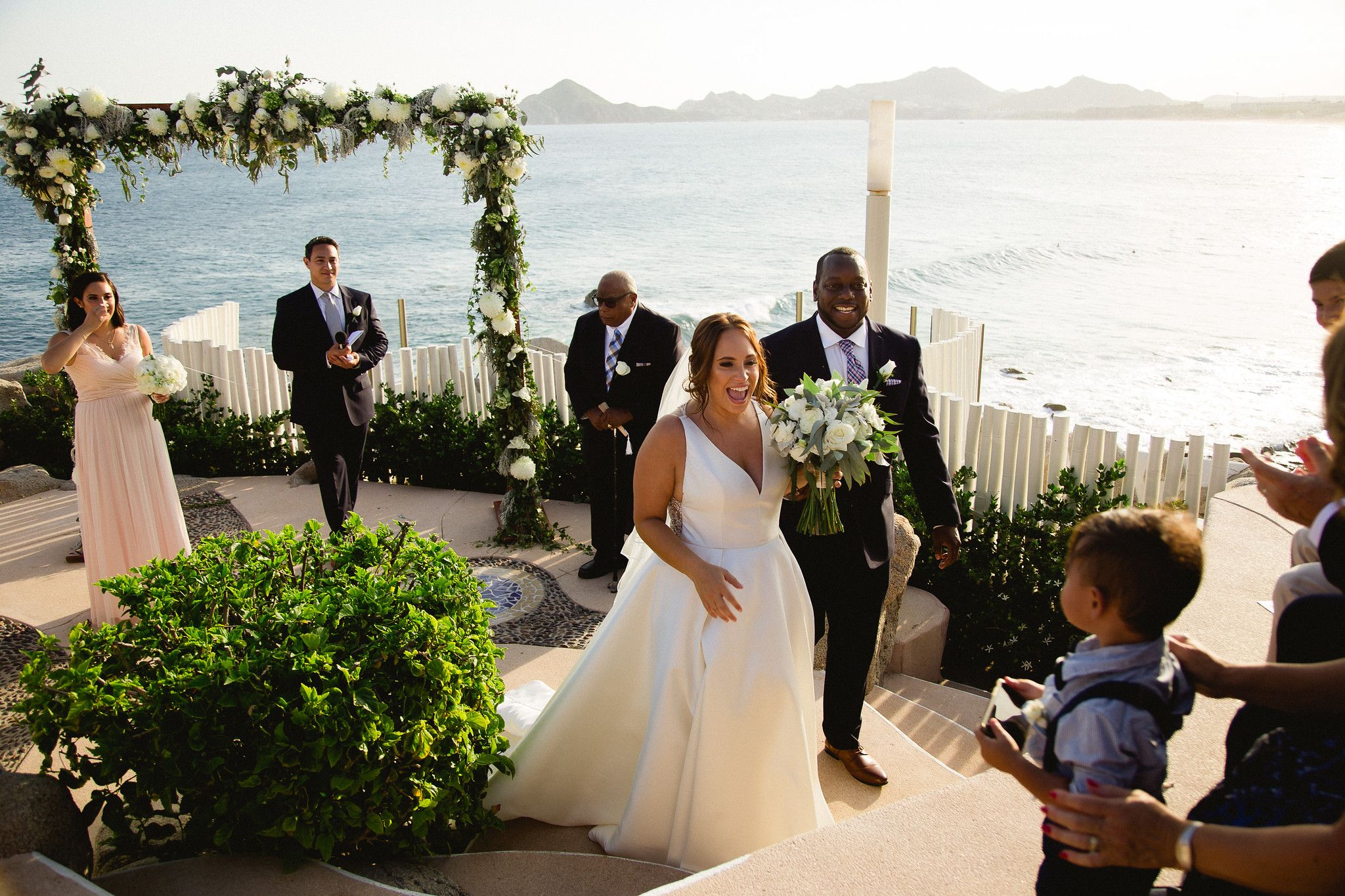 Bride and groom after wedding ceremony at Wedding Venue in Cabo San Lucas Sunset da Mona Lisa. Wedding planning and design by Cabo Wedding Services