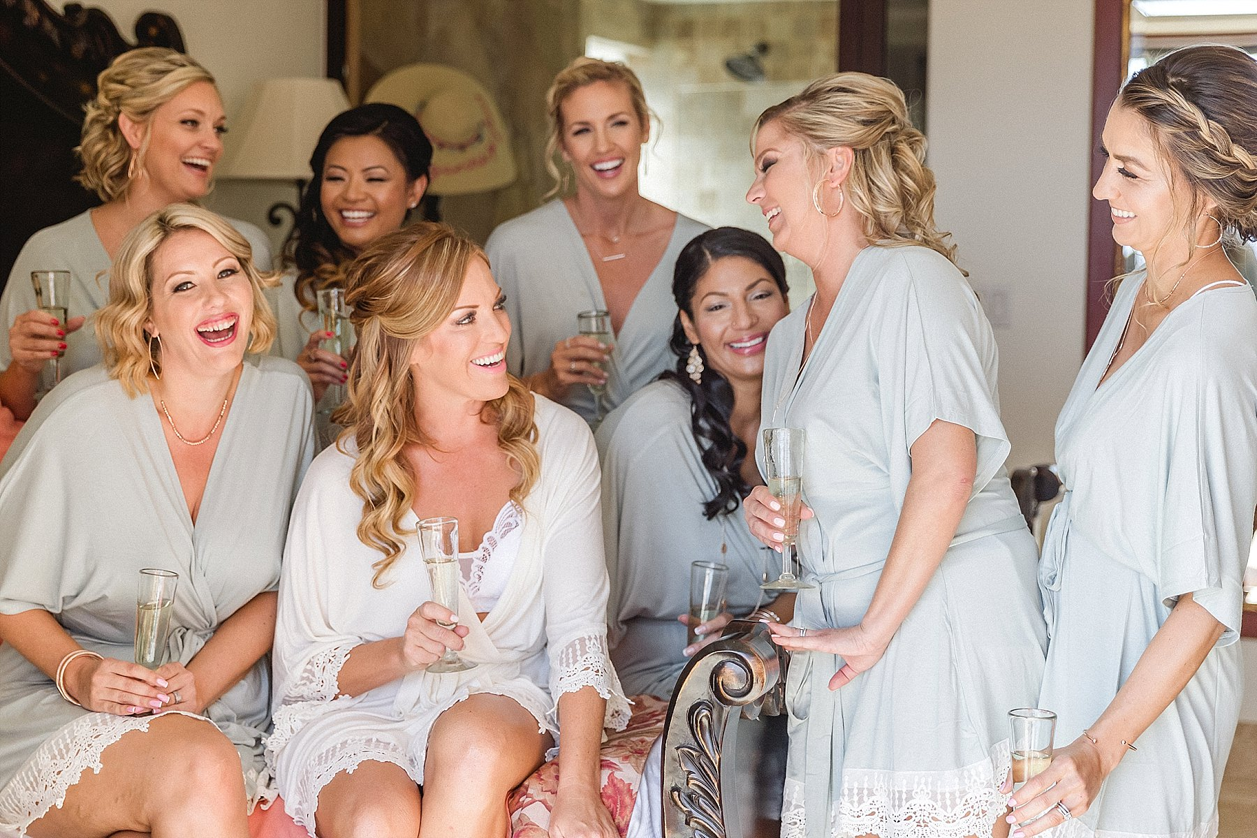 Bride drinking Champagne with her Bridesmaids at Hacienda Encantada in Cabo San Lucas, Mexico. Wedding Planning by Cabo Wedding Services and the Wedding took place at Flora Farms.