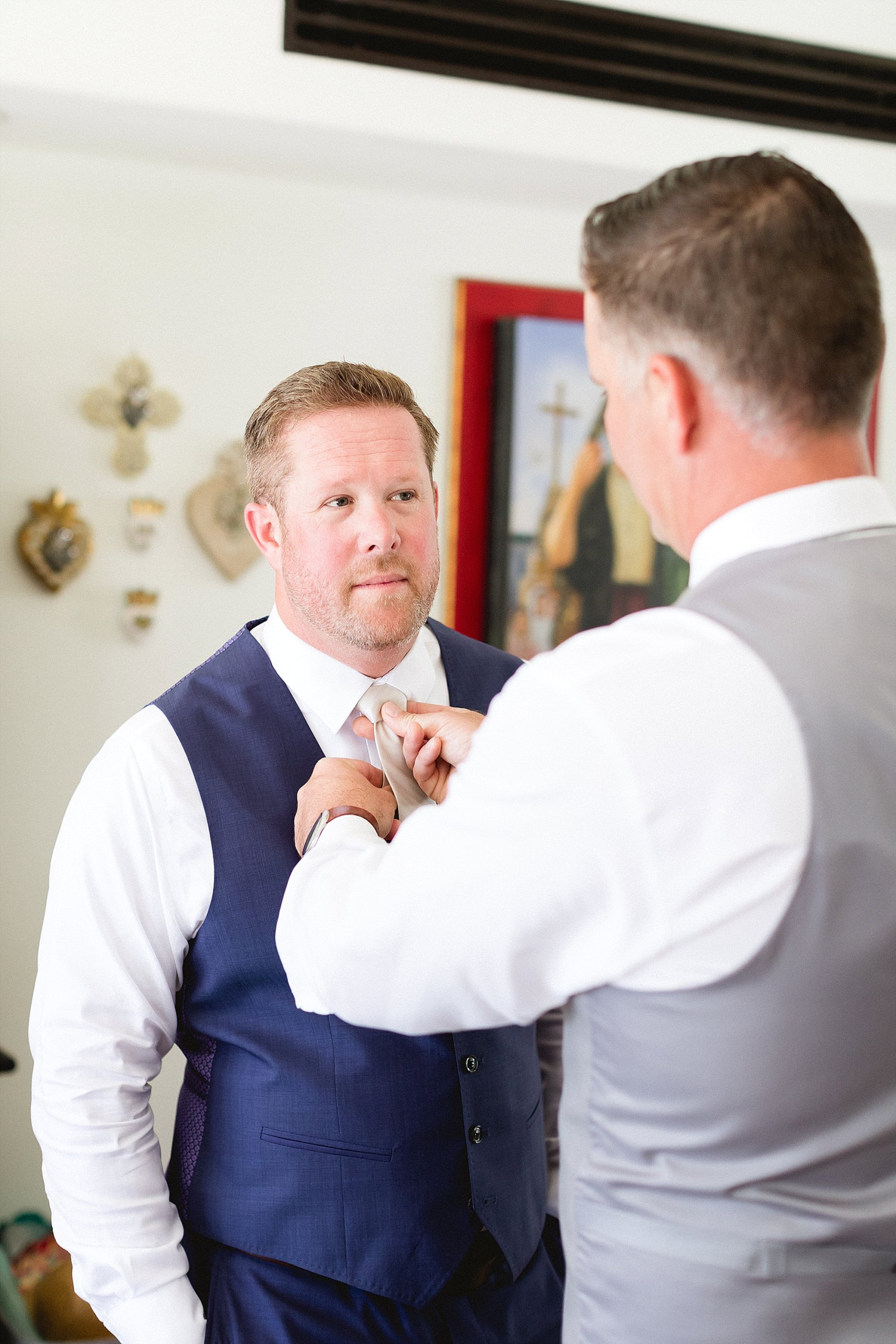 Groom getting ready at Hacienda Encantada in Cabo San Lucas Mexico, getting ready to head to his Wedding Venue at Flora Farms in Los Cabos, Mexico. Wedding Planning by Cabo Wedding Services and Photography by Sara Richardson,