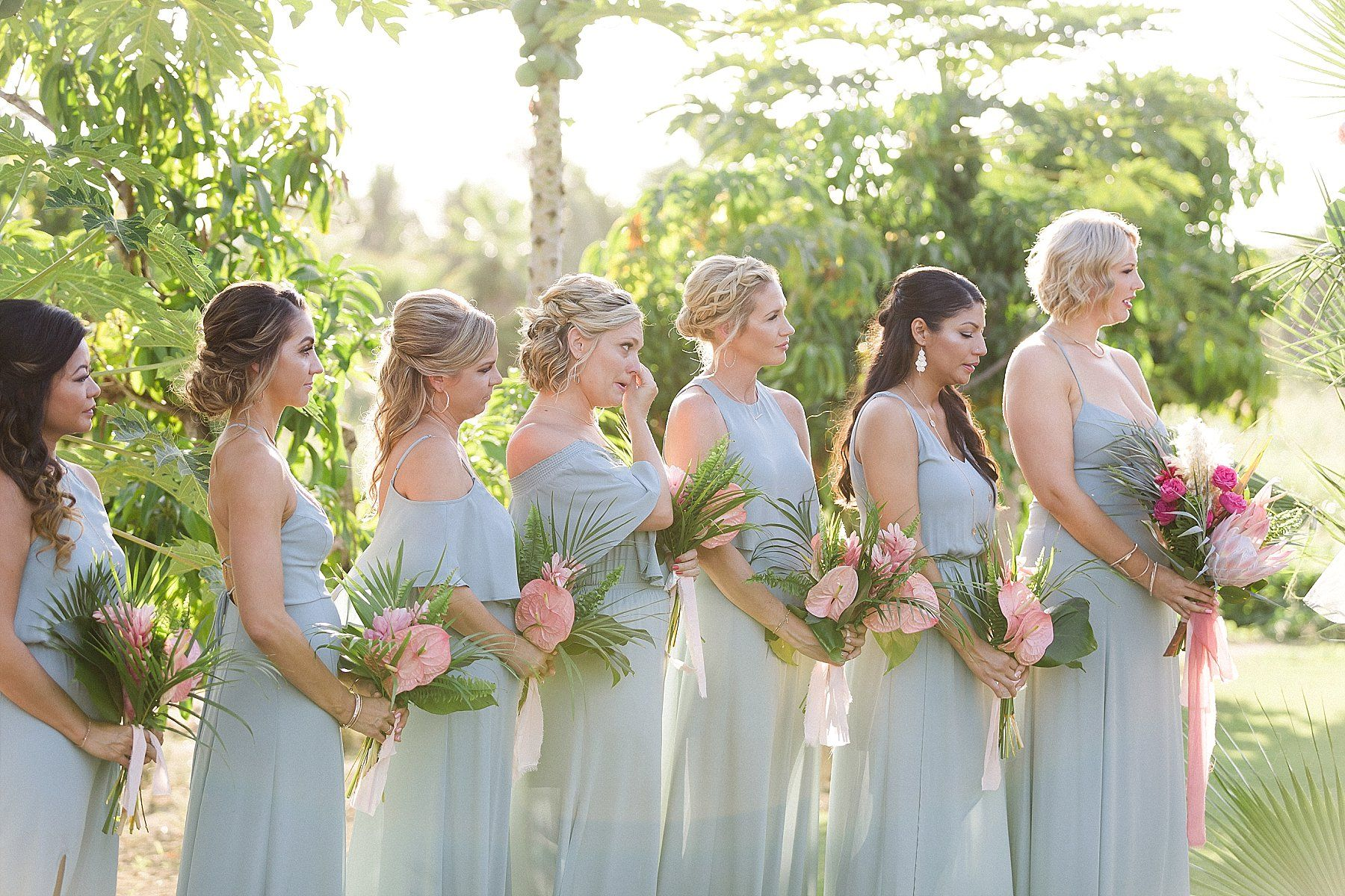 Bridesmaids standing during Wedding Ceremony at Flora Farms in Cabo San Lucas Mexico. Destination Wedding Planning by Cabo Wedding Services. Wedding Photography by Sara Richardson