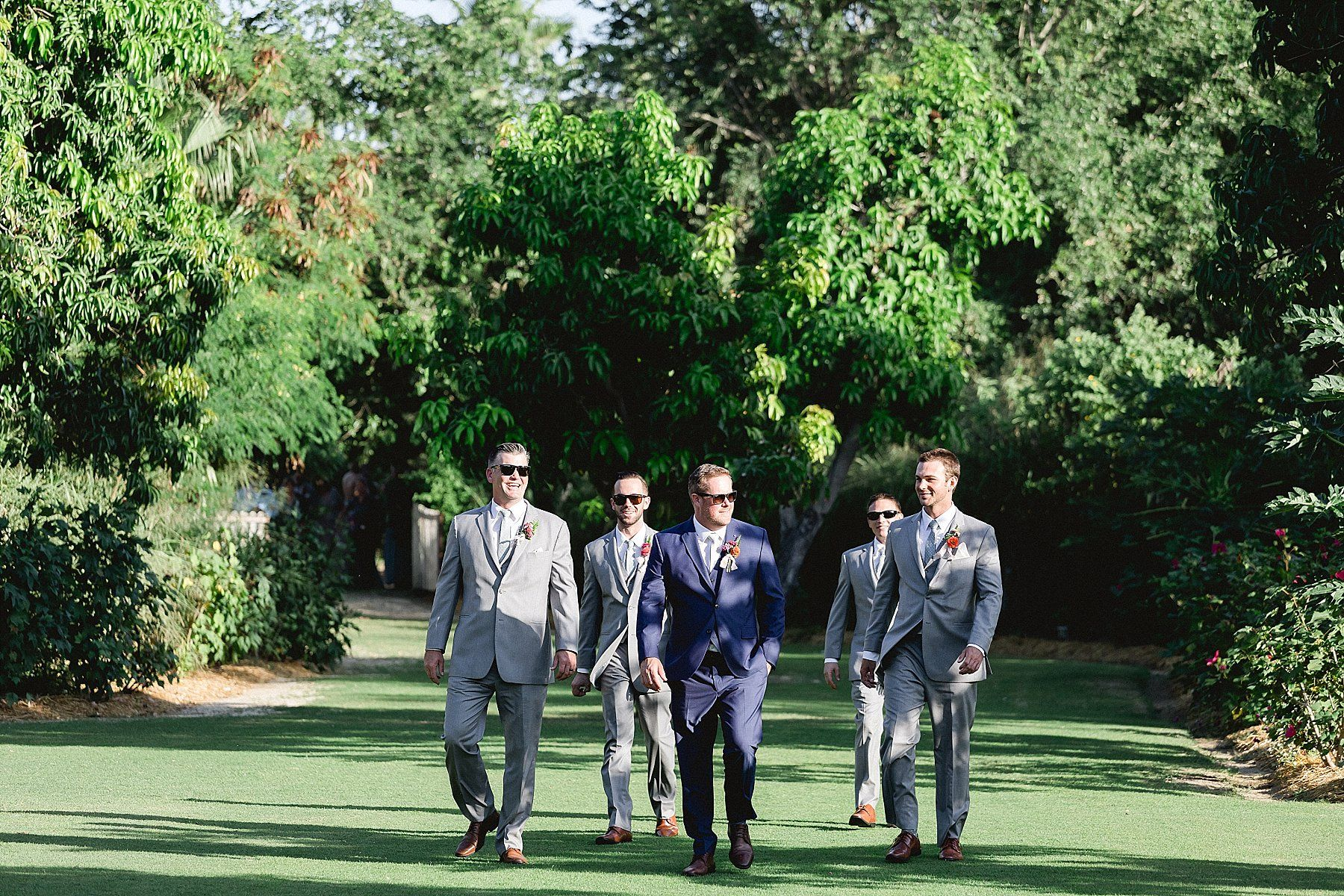 Groom with his Groomsmen walking down the Ceremony. This venue is in Los Cabos, Mexico and it is called Flora Farms. Wedding Planning by Cabo Wedding Services.