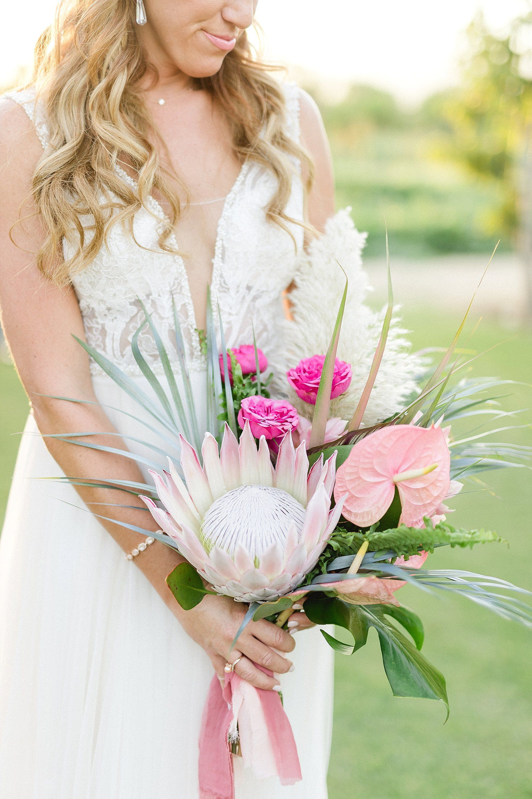 Bridal Bouquet with Proteas and Anthuriums. Wedding Venue at Flora Farms in Los Cabos, Mexico. Wedding Planning by Cabo Wedding Services and Wedding Photography by Sara Richardson