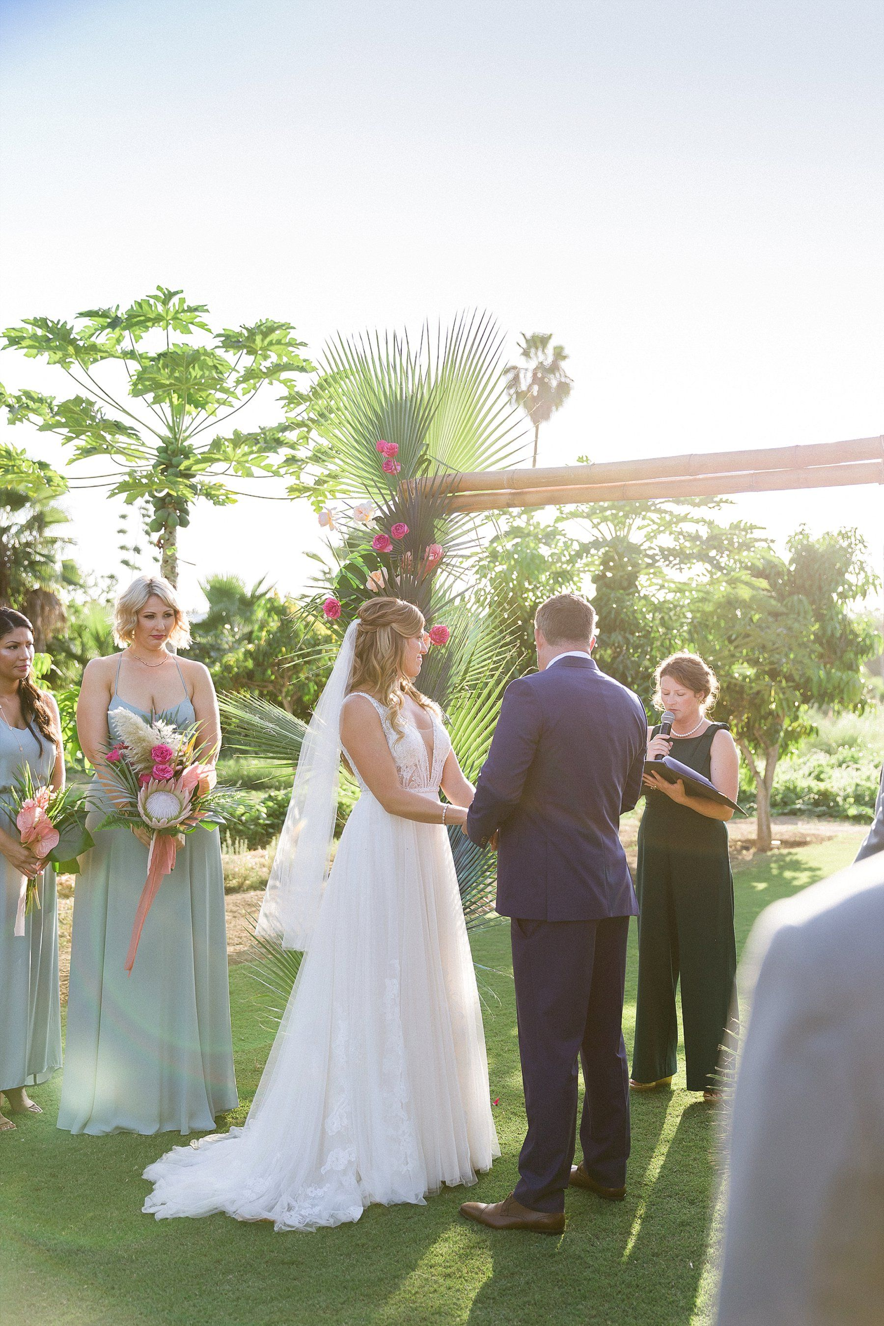 Bride and Groom standing at the front during Wedding Ceremony at Flora Farms in Los Cabos Mexico. Wedding Planning by Cabo Wedding Services and Photography by Sara Richardson