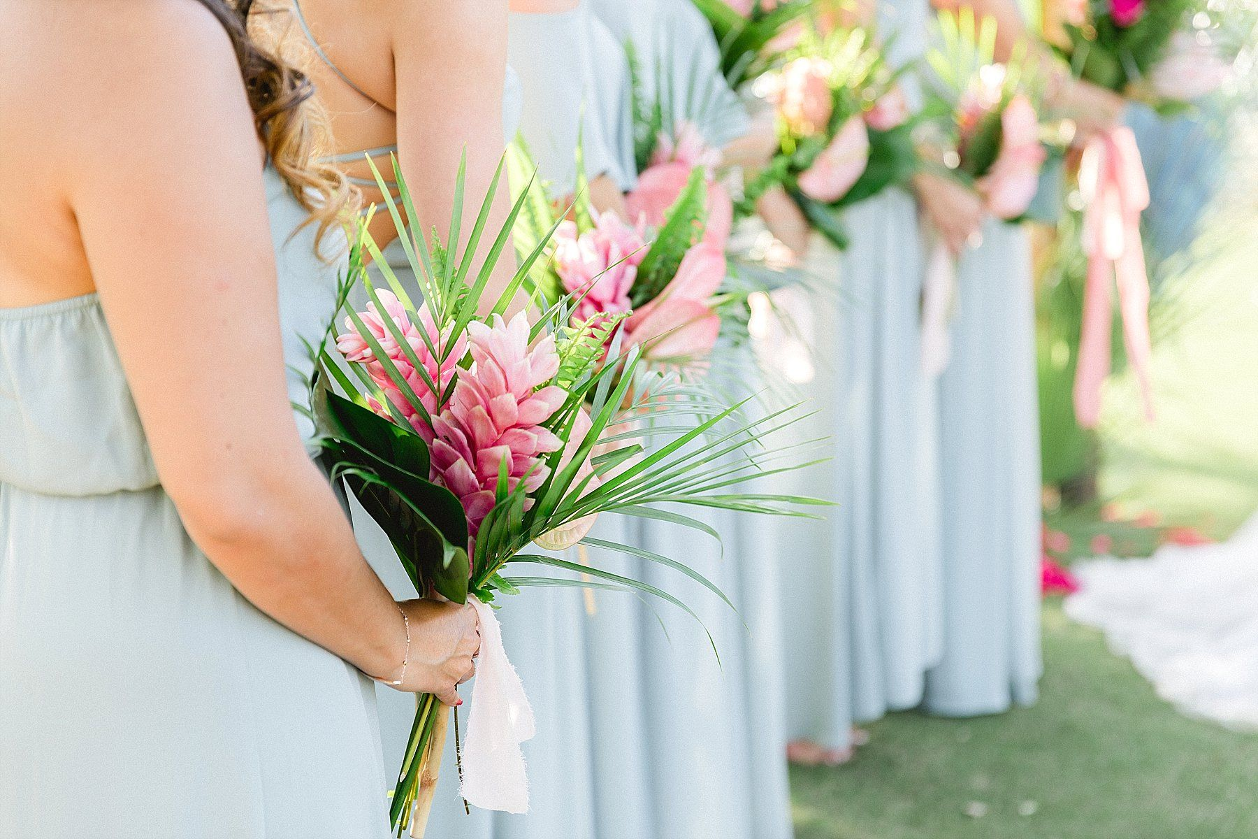 Bridesmaids lined up during the Ceremony at Wedding Venue Flora Farms in Los Cabos Mexico. Wedding Planning by Cabo Wedding Services and Wedding Photography by Sara Richardson