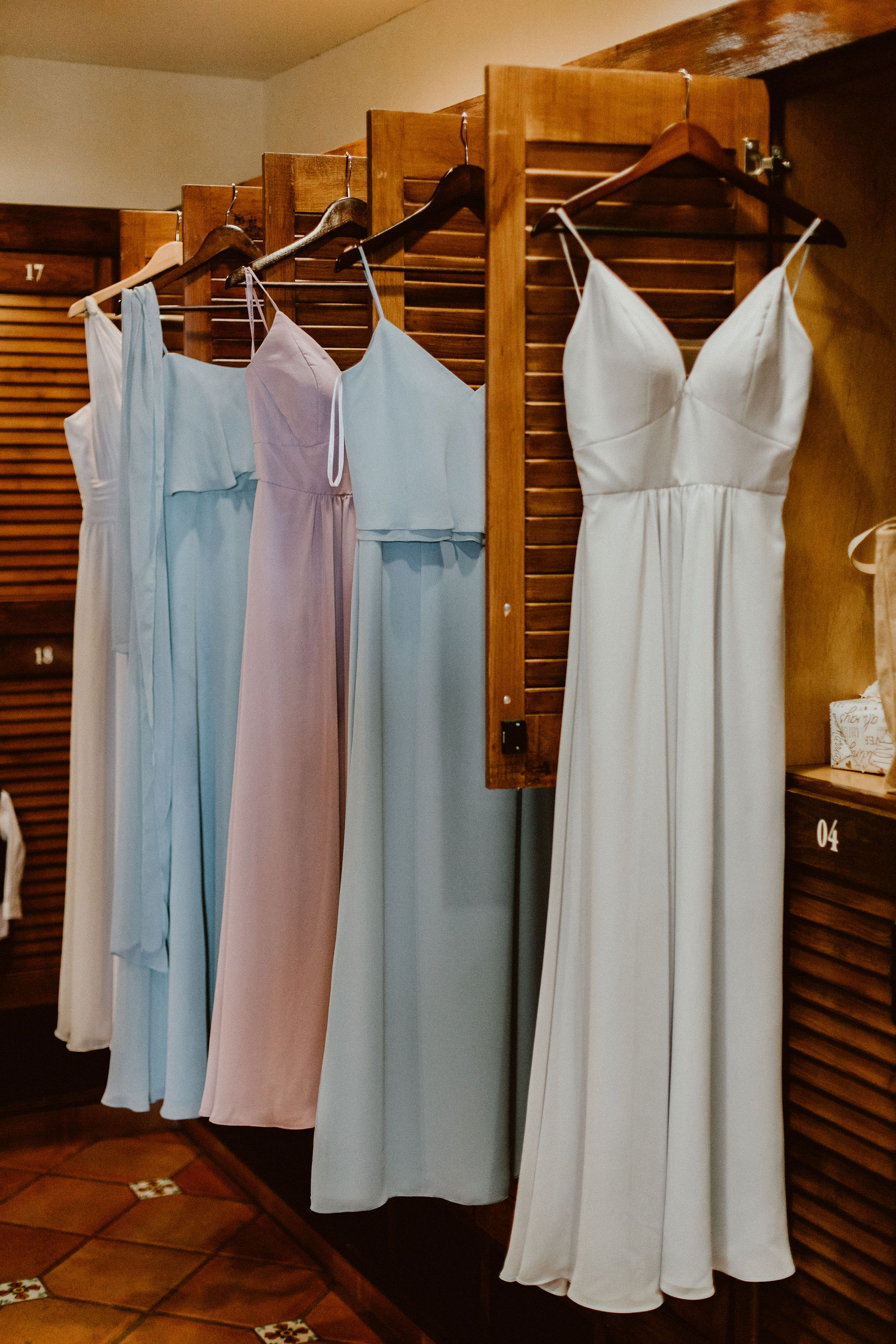 Bridesmaid Dresses hung in the Bridal Suite at Cabo del Sol Club House in Cabo San Lucas Mexico. This was Jen and Ians Wedding day in January, 2019. This was our First Wedding of the year. There were 50 of their best friends and family.