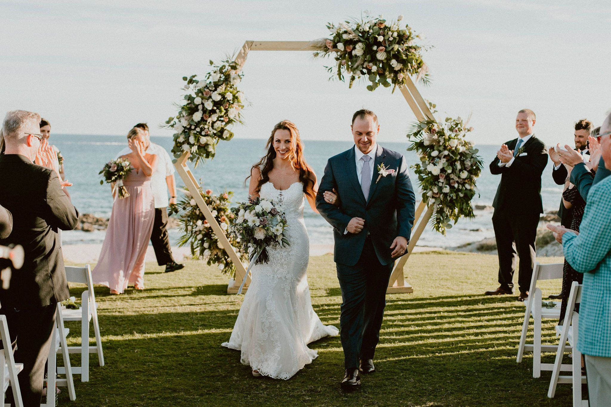 Bride and Groom after the Wedding Ceremony at Cabo del Sol. Destination Wedding Planning by Cabo Wedding Services. Wedding Designer Jesse Wolff