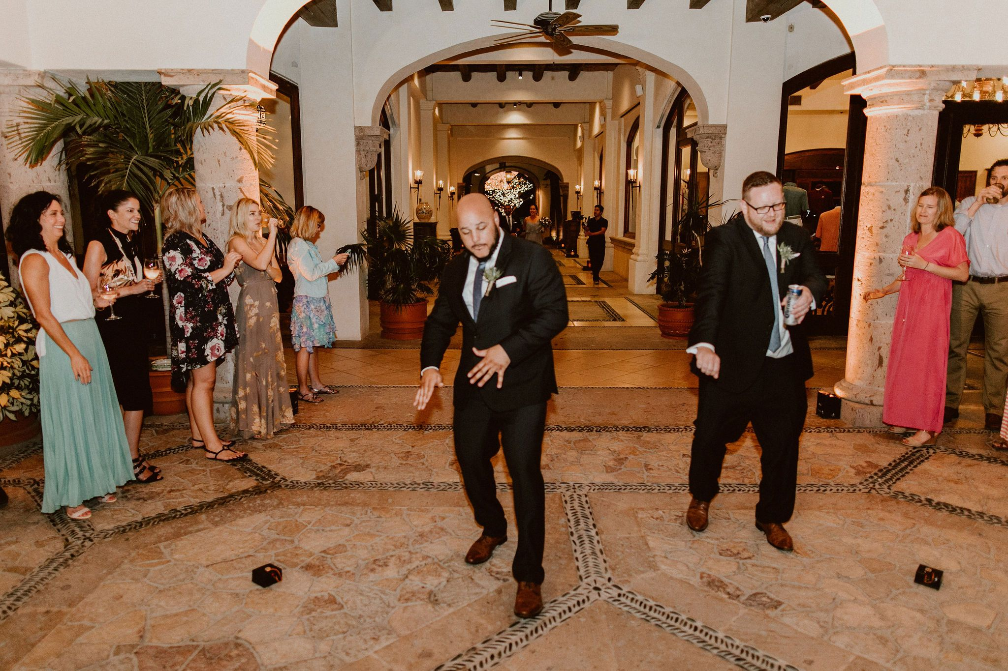 Groomsmen dancing at the Bridal Party Grand Entrance, prior to the Bride and Groom entering. Wedding Destination at Cabo del Sol, in Los Cabos, Mexico. Wedding Planning by Cabo Wedding Services