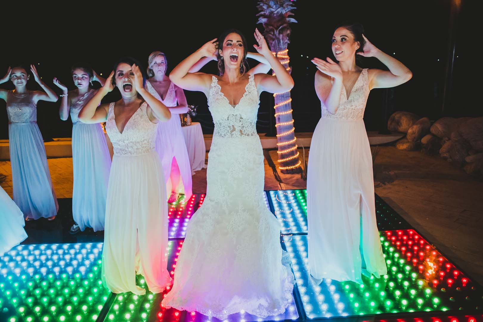 Bride dancing with her bridesmaids on LED dance floor. They had such a good time on Jessica's wedding day at Villa del Palmar in Los Cabos, Mexico.