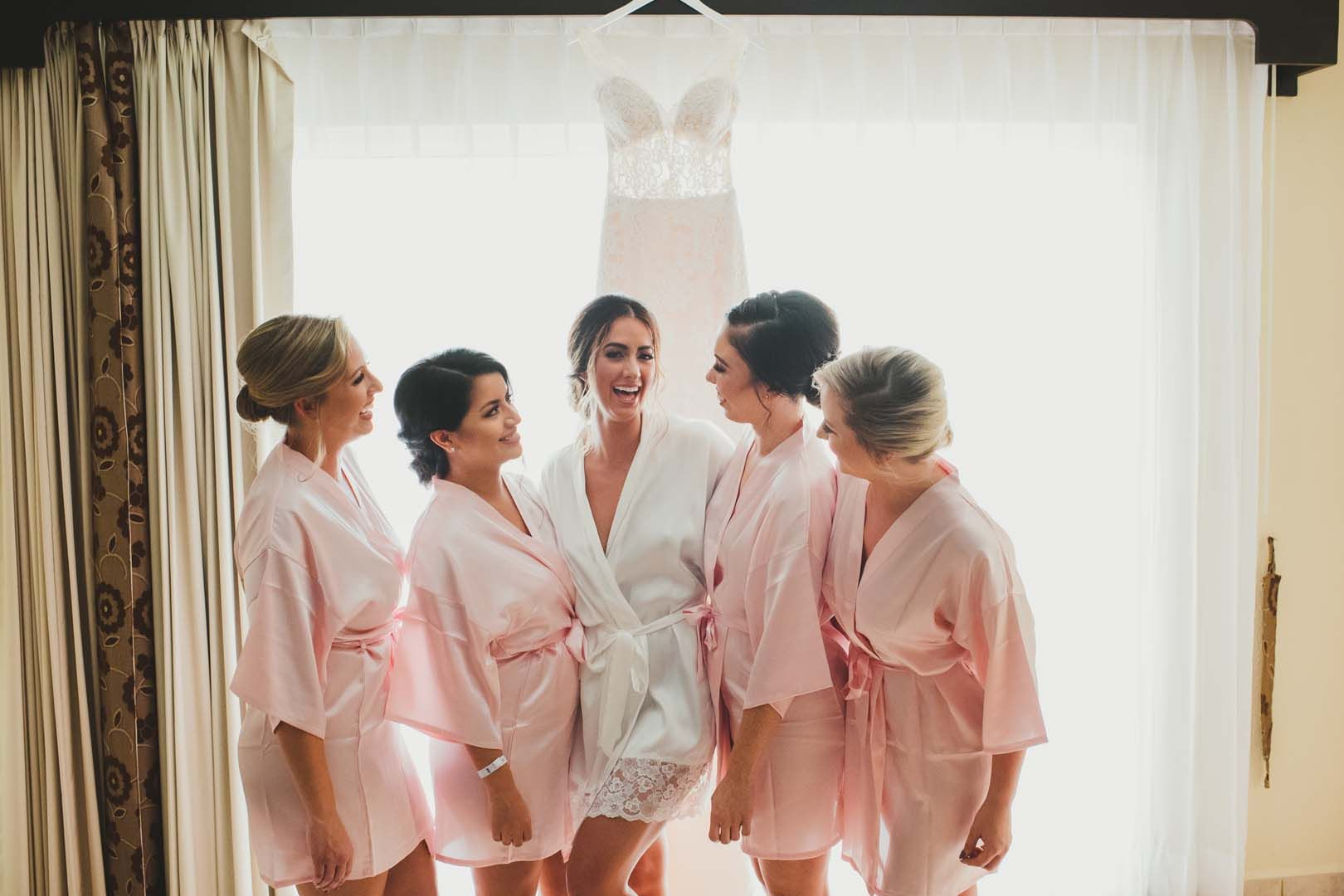 Bride hanging out with her Bridesmaids in the hotel room at Villa del Palmar in Los Cabos, Mexico.