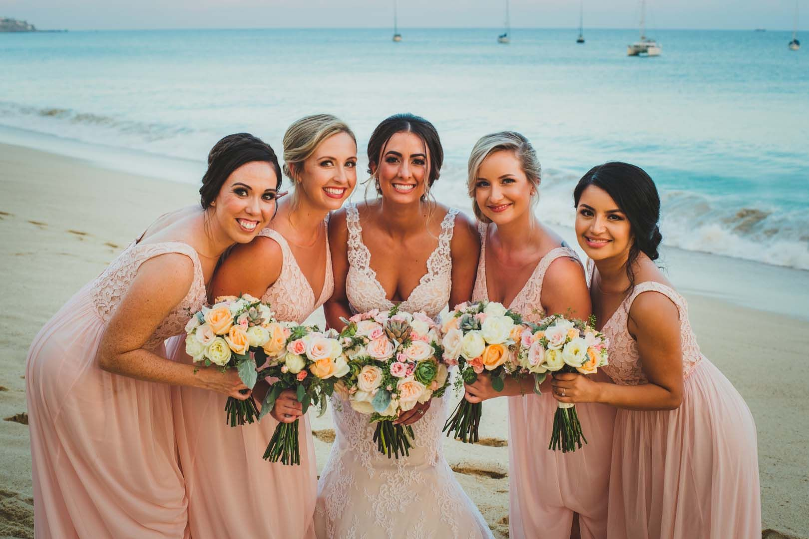 Bride with Bridesmaids in Los Cabos Mexico, during a photo session after her wedding ceremony at the Evangelista church, located downtown Cabo San Lucas, Mexico.