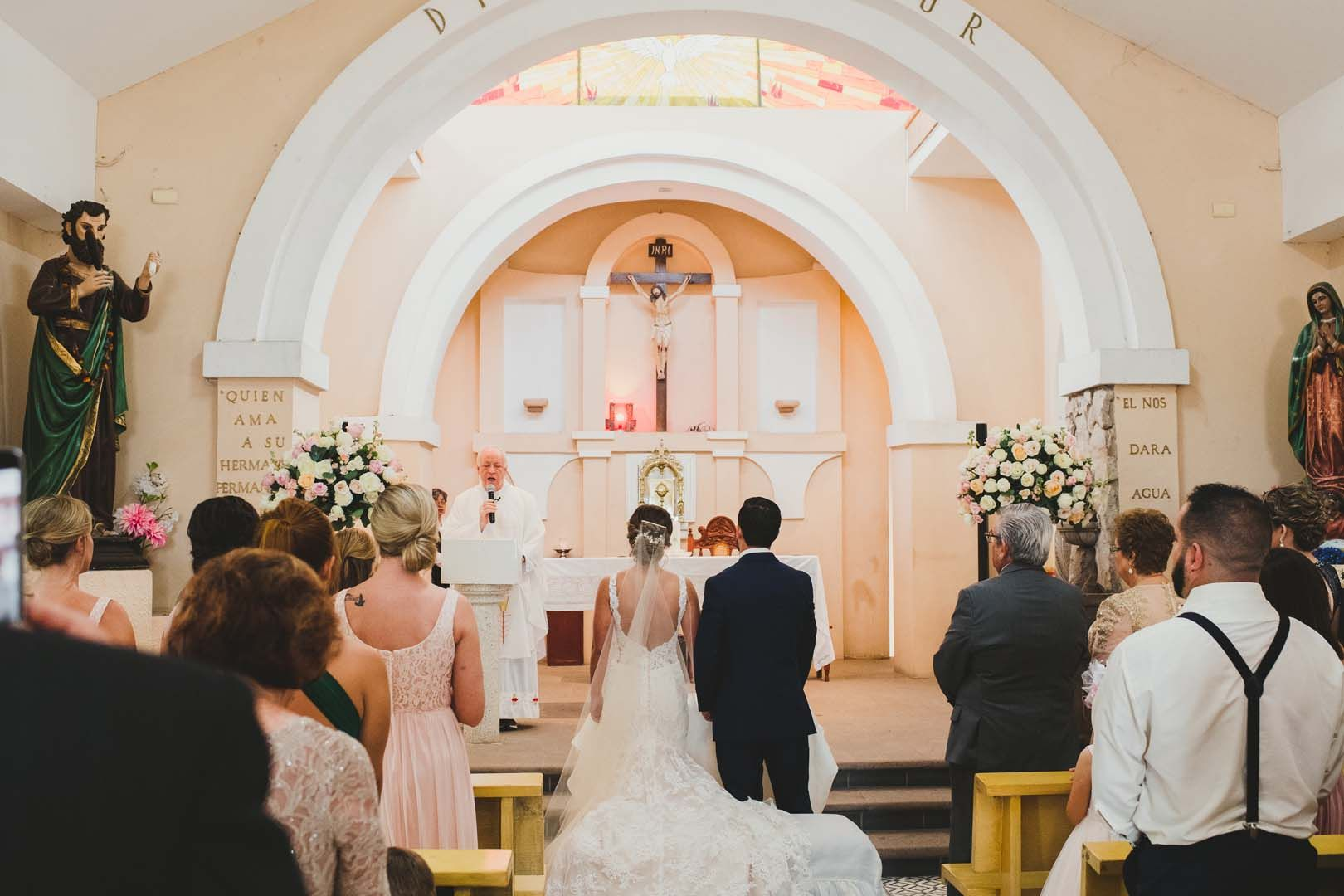 Bride and Groom standing in front of Father Antonio at his Church in Los Cabos Mexico. Wedding Planning was done by Cabo Wedding Services