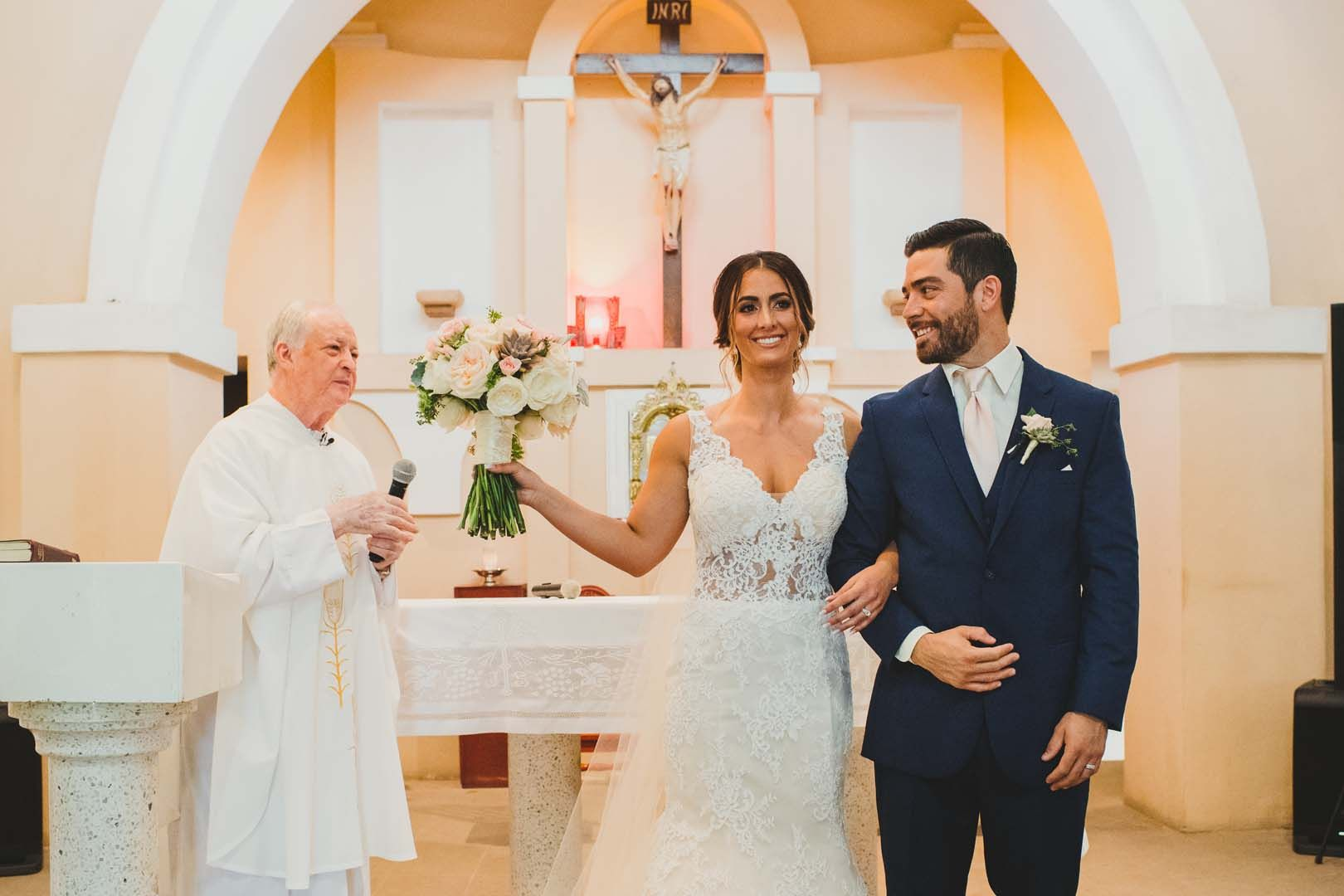 Bride and Groom just being pronounced Husband and Wife at the Evangelista Church. This wedding took place in Los Cabos Mexico. Wedding Planning by Cabo Wedding Services