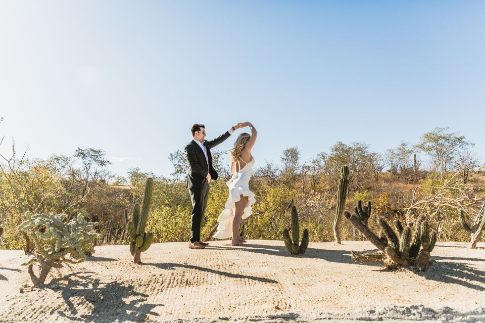 Lauren and James, bride and groom, during their photo session in Los Cabos Mexico. Wedding Venue was The Cape and they did their photo session around Los Cabos, in the Desert.