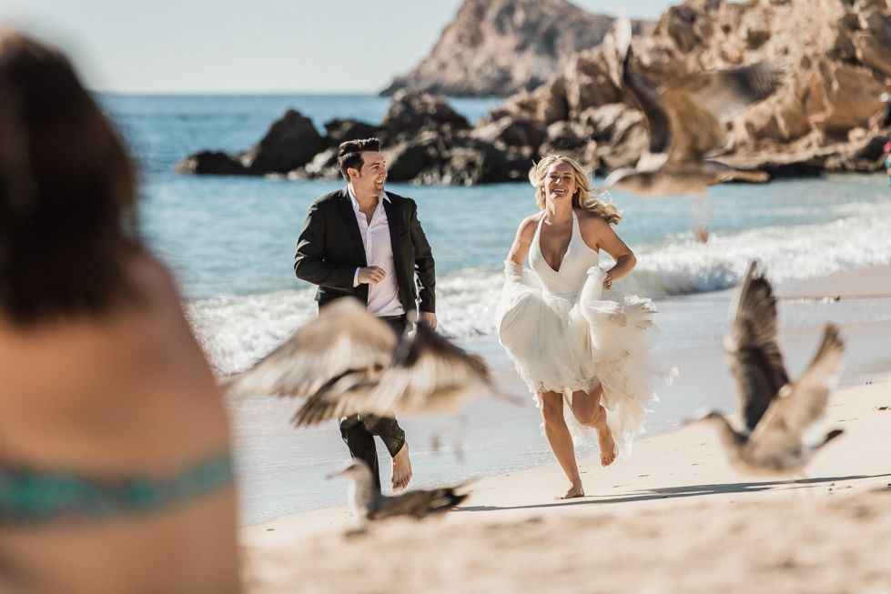 Bride and Groom running during their photo session at the beach the day after their wedding. They decided to go with Local Photographer Daniel Jireh. Wedding Planning done by Jesse Wolff at Cabo Wedding Services.