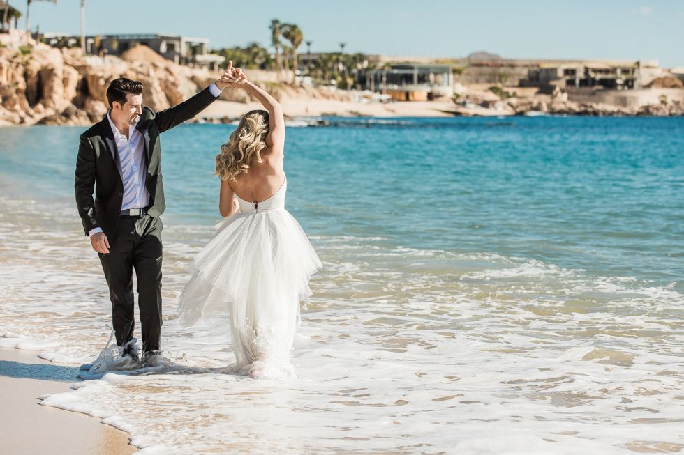 Bride and Groom photo Session at The Cape. Cabo Wedding Planning by Cabo Wedding Services. Photography done by local Photographer Daniel Jireh.