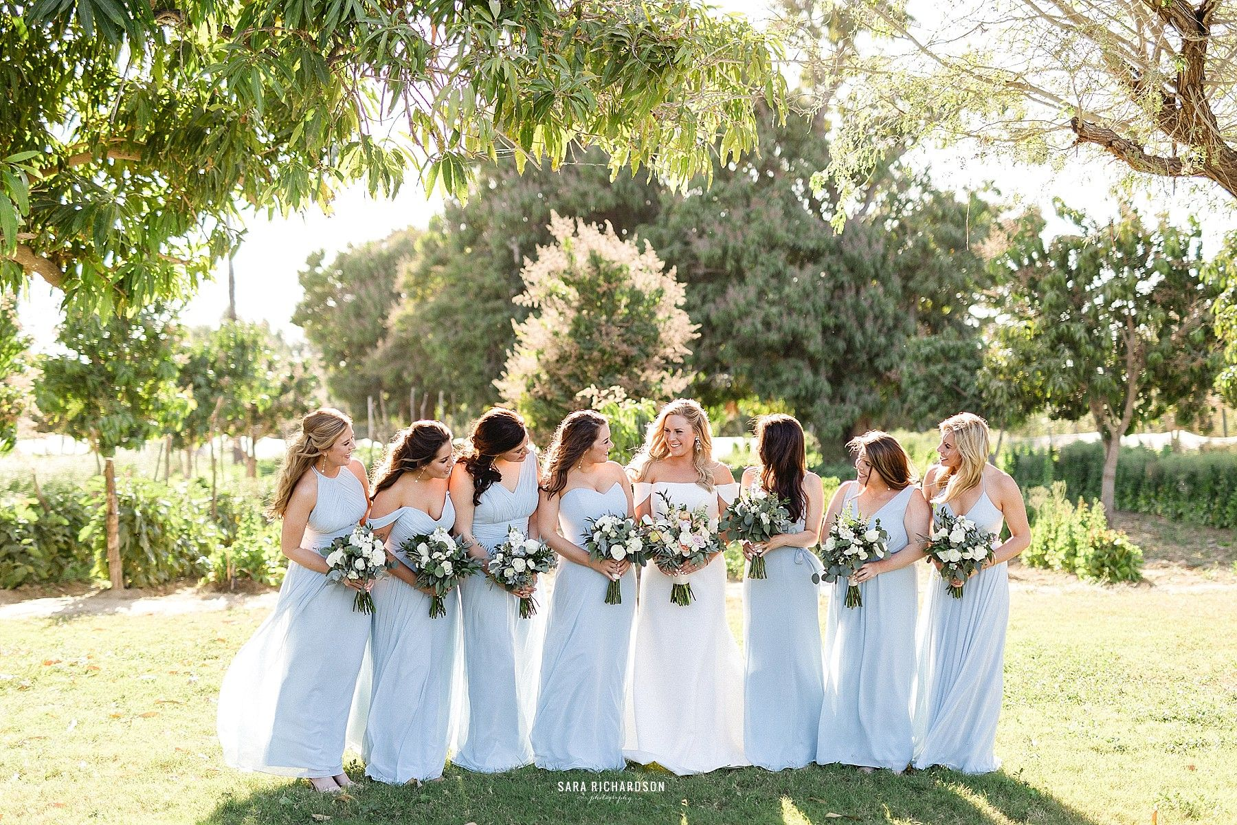 Bride with her Bridesmaids after the ceremony in a quick photo session.
