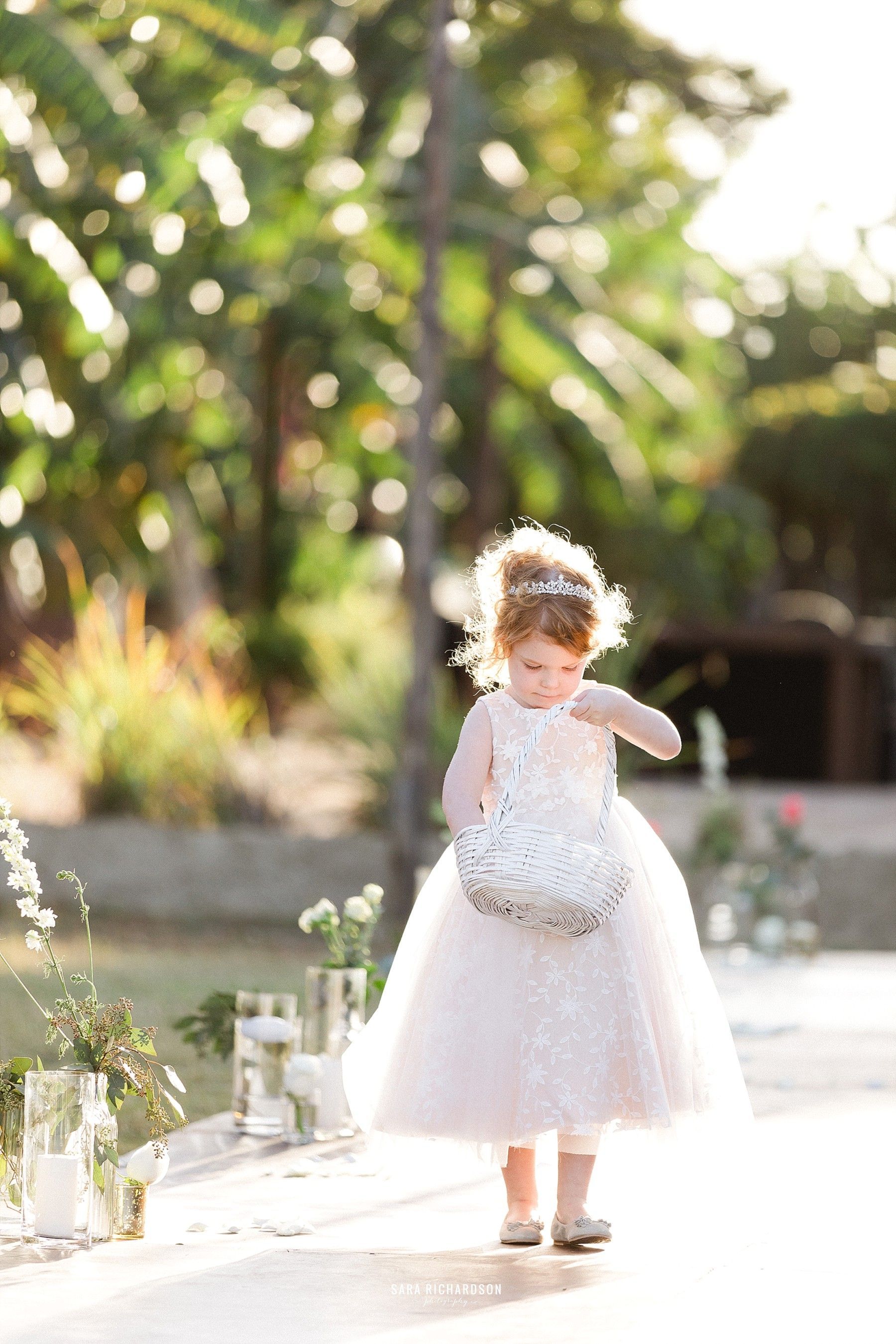 The cutest flower girl ever! She walked down that aisle and owned it! The Bride and Groom's photographer, Sara Richardson, was able to capture such beautiful moments!