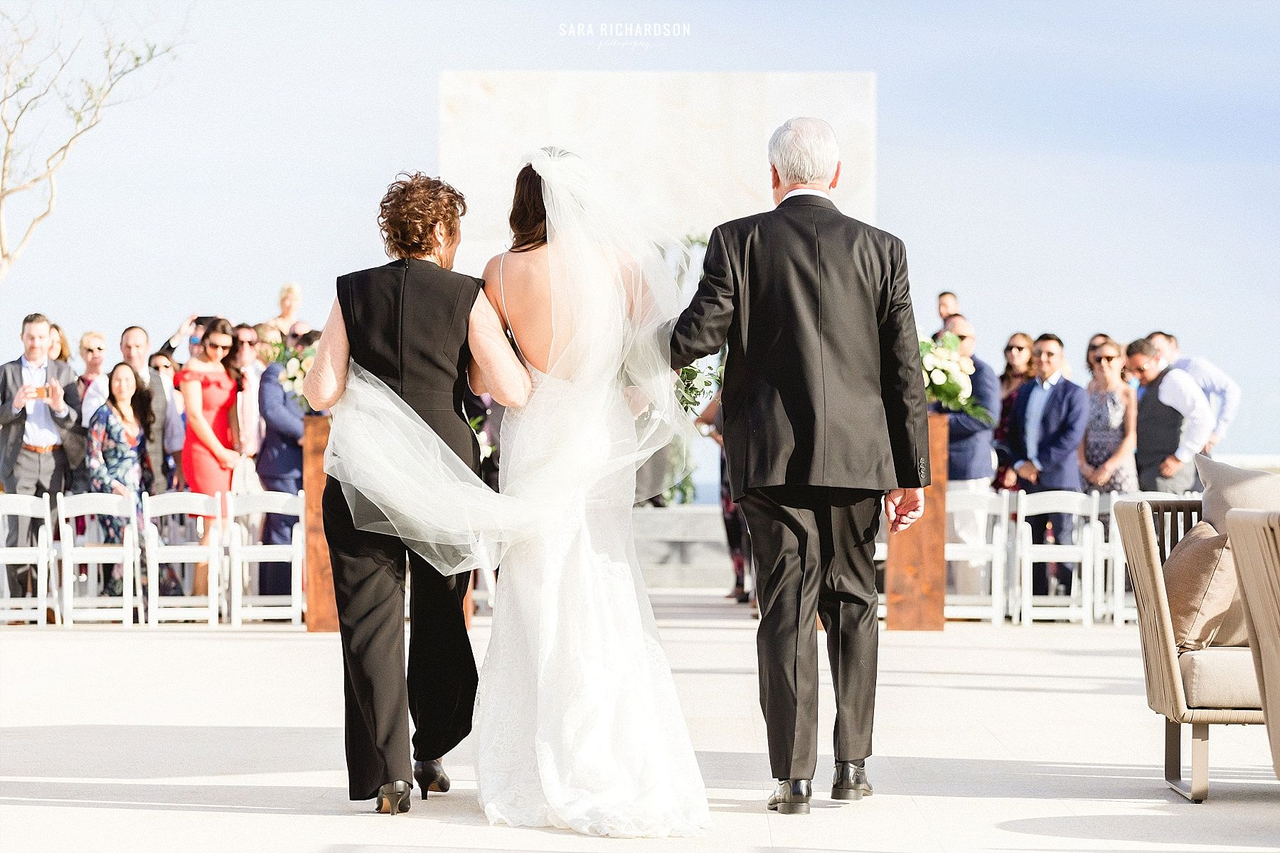 Bride walking down to her Groom during the Wedding Ceremony at LeBlanc in Los Cabos Mexico.
