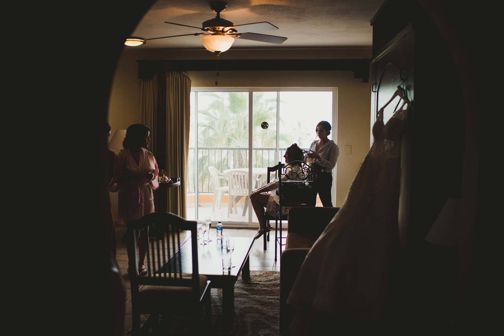 Paparazi shot of Bride getting her Hair + Makeup on her Wedding Day by Bri Berliner. She was getting ready in her hotel room at Villa del Palmar, in Los Cabos, Mexico.